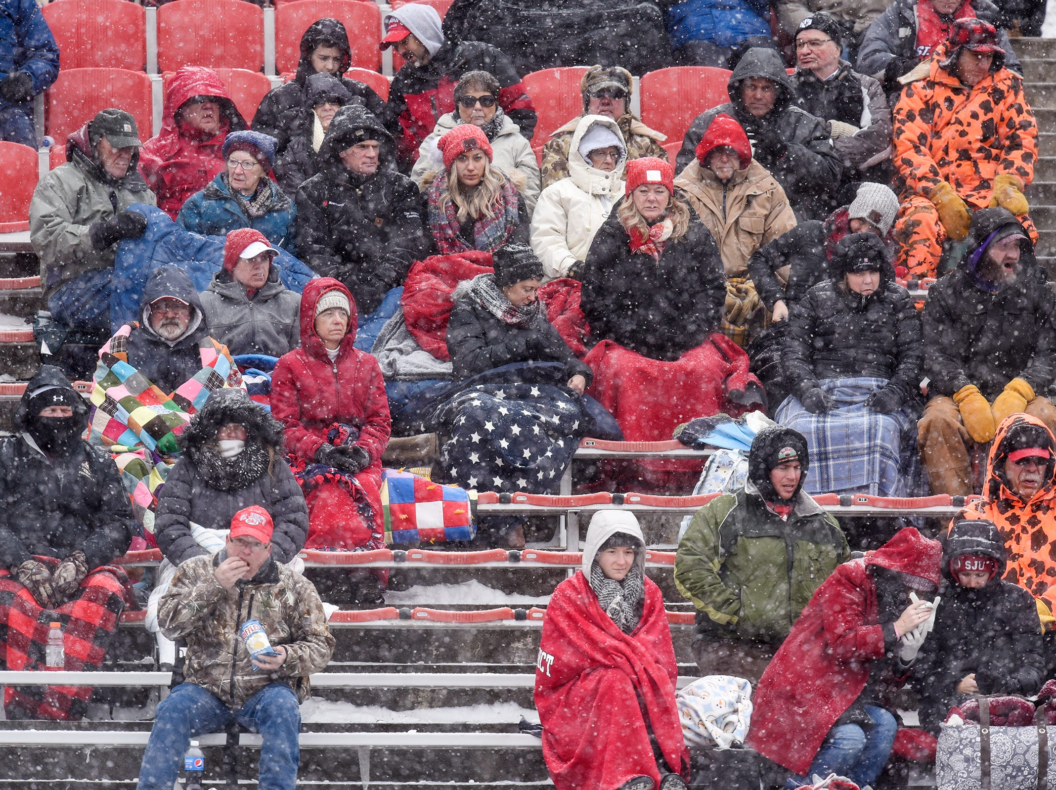 Heavy snow falls during the first half of the Saturday, Nov. 10, game against Thomas More University at Clemens Stadium in Collegeville.