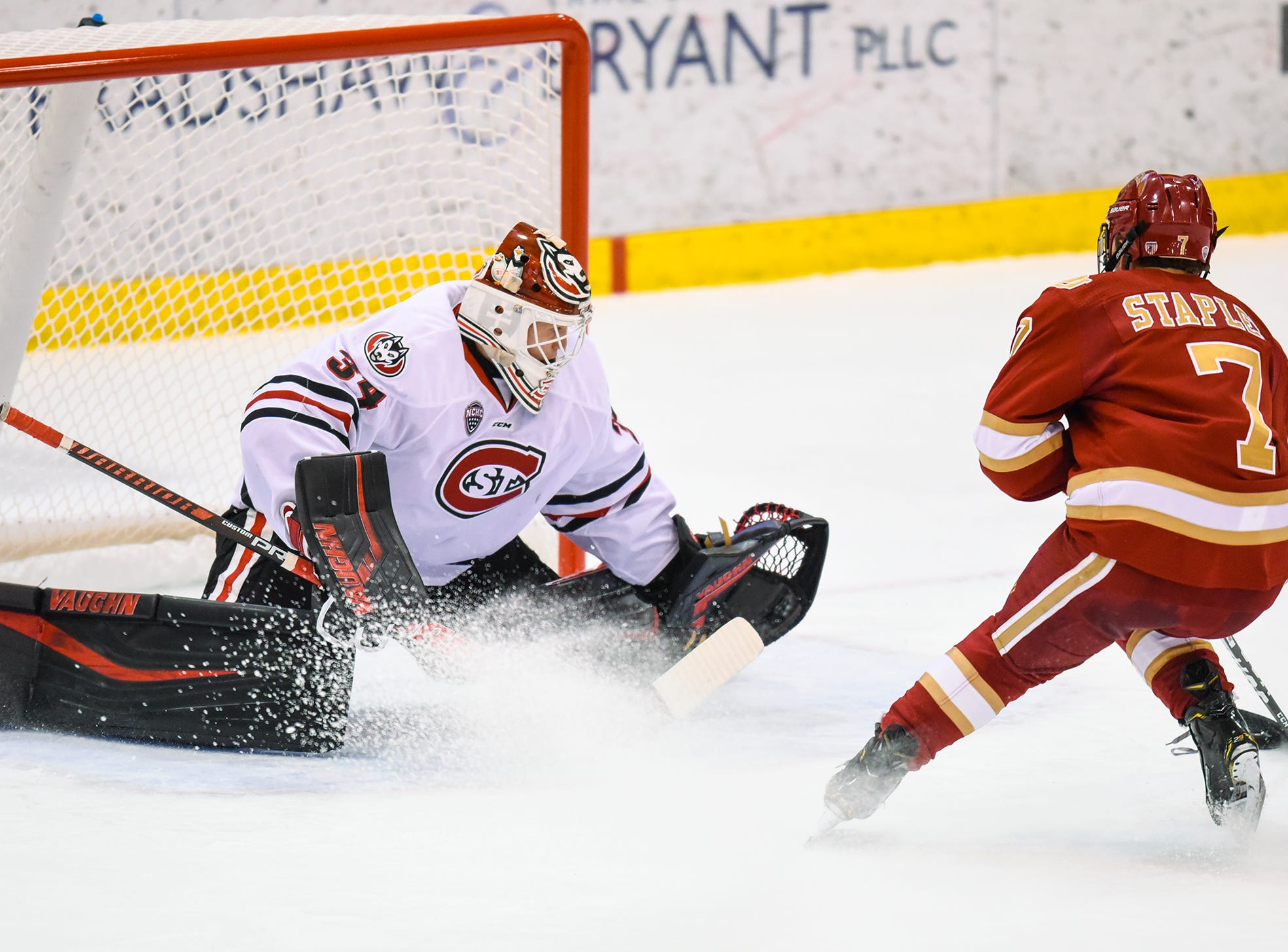 St. Cloud State goaltender David Hrenak concentrates on a shot by Denver's Brett Stapley during the first period of the Friday, Nov. 9, game at the Herb Brooks National Hockey Center in St. Cloud.