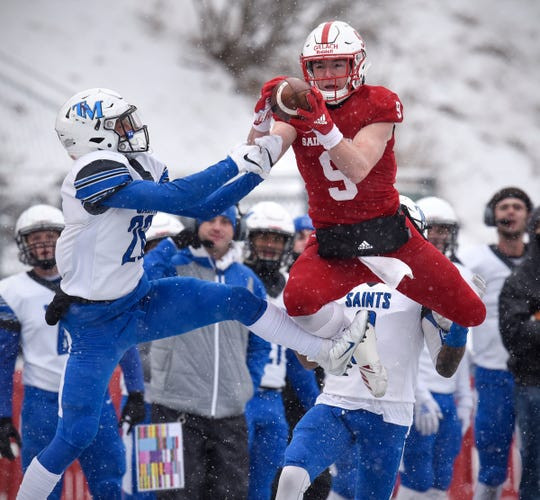 Will Gillach of St. John's leaps to make a reception during the first half of the Saturday, Nov. 10, game against Thomas Moore University at Clemens Stadium in Collegeville.