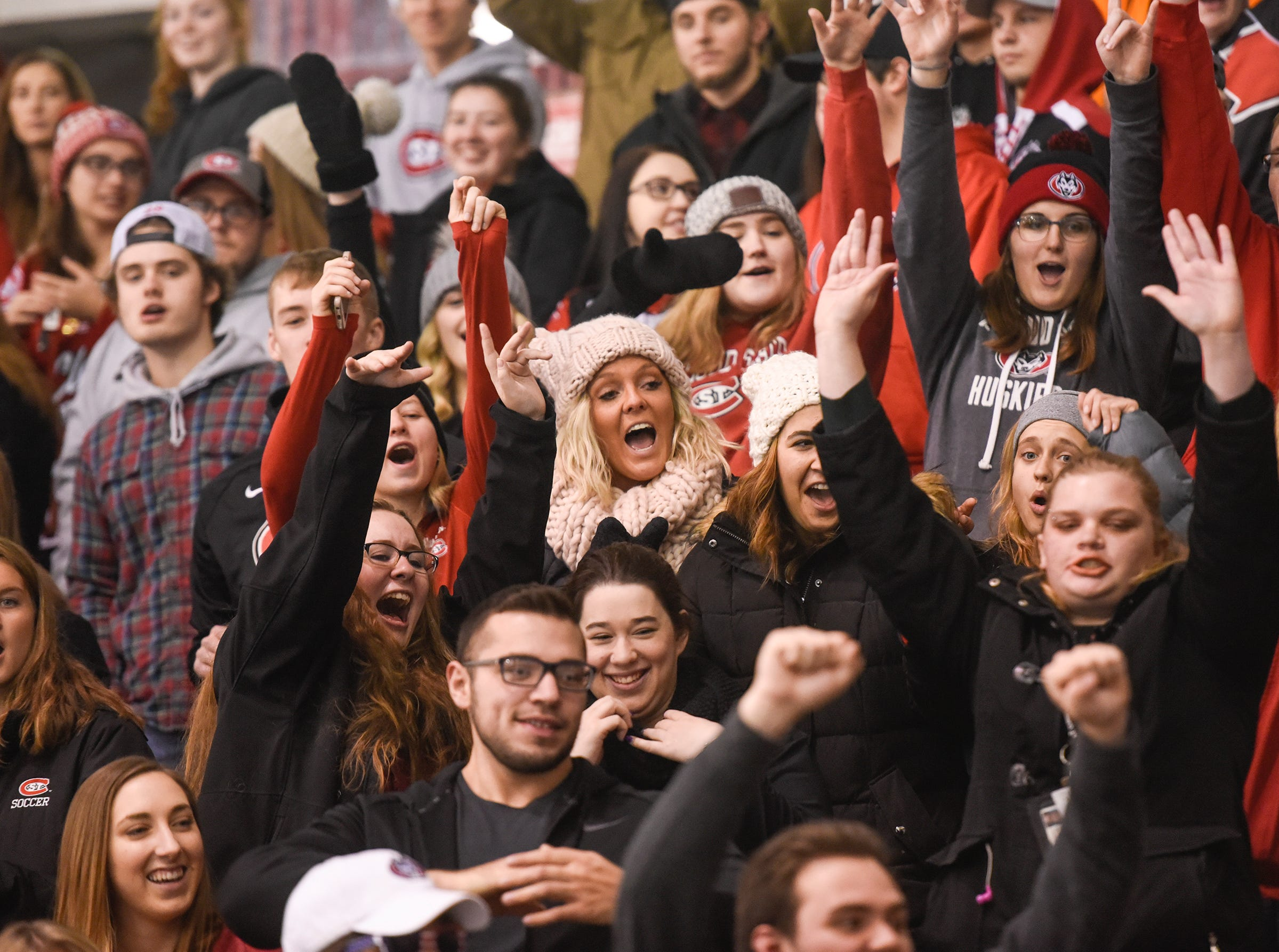 Husky fans cheer during the first period of the Friday, Nov. 9, game against Denver at the Herb Brooks National Hockey Center in St. Cloud.