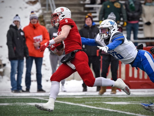 Will Gillach escapes for a big gain during the first half of the Saturday, Nov. 10, game against Thomas Moore University at Clemens Stadium in Collegeville.