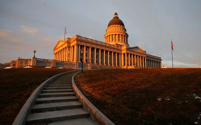 In this March 8, 2018, file photo, the sunsets on the Utah State Capitol, in Salt Lake City.