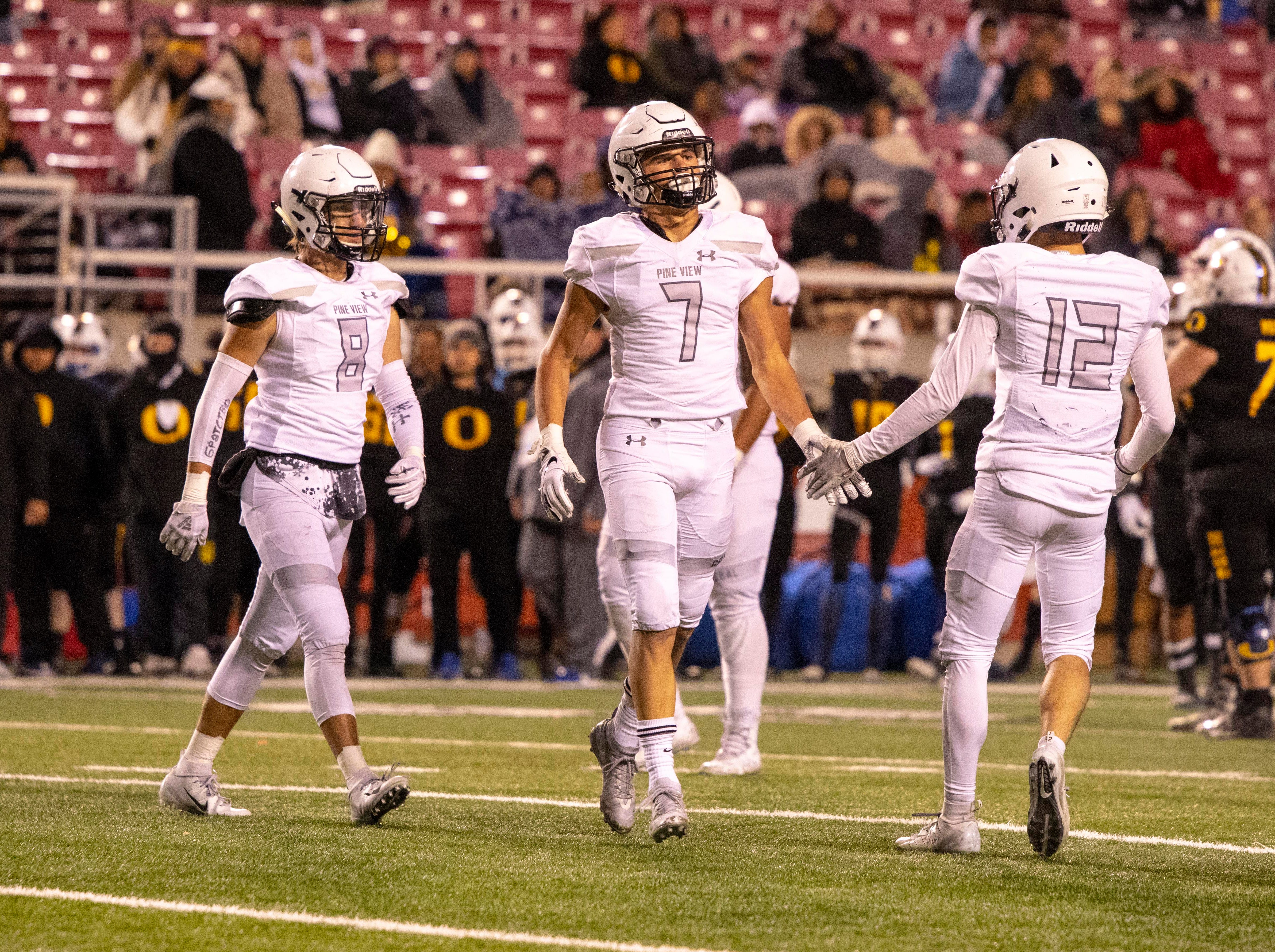 Pine View's Daylor Rymer (7) celebrates an interception with teammates during Friday's playoff game against Orem in Salt Lake City, Nov. 9, 2018.