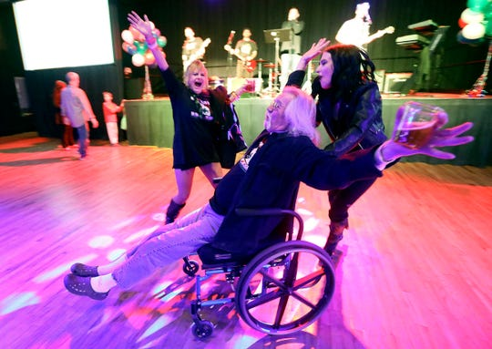 """We did it!"" yells Shawn McDonald, center, as he celebrates with Teisha Martinez, left, and Aubrey Taylor after a local media outlet called results showing Proposition 2 passed at the Proposition 2 election night party at the Infinity Event Center in Salt Lake City, Utah, on Tuesday, Nov. 6, 2018. Proposition 2 legalizes the medical use of marijuana for individuals with qualifying medical illnesses. (Kristin Murphy/The Deseret News via AP)"