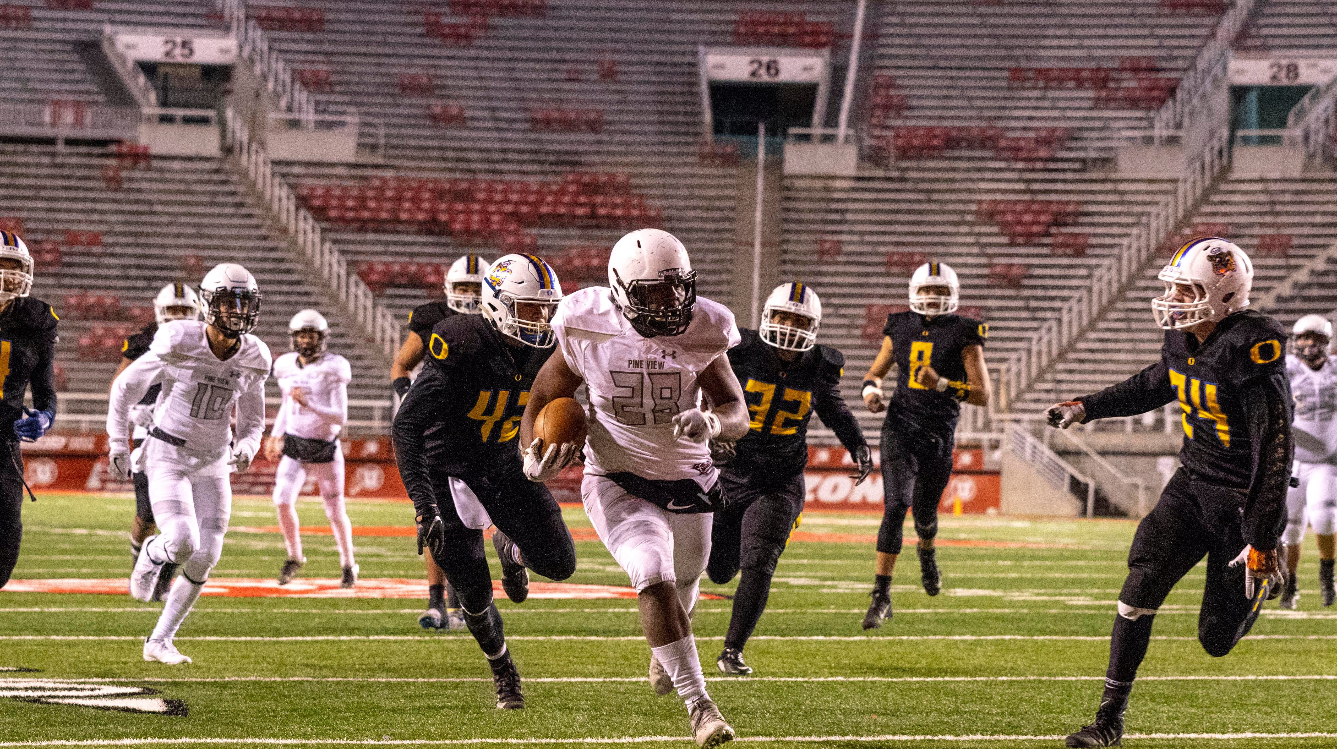 Pine View running back Tosh Wright (28) rushes for a touchdown during Friday's playoff game against Orem in Salt Lake City, Nov. 9, 2018.