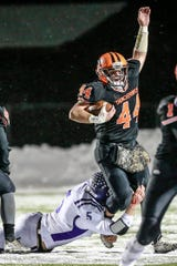 Iola-Scandinavia's Bryce Huettner became the state's all-time career rushing leader with 6,714 yards in a Division 6 state semifinal win last week. He broke the record of 6,707 set by Mike Firkus of Hilbert from 2000-02.