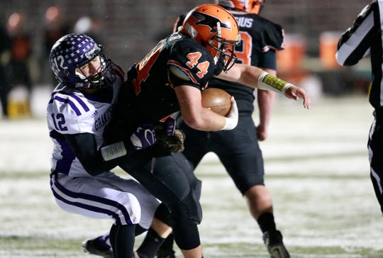 Grantsburg's Reed Arnold (12), left, tackles Iola-Scandinavia's Bryce Huettner (44) on the goal line Friday during a WIAA state football semifinal at Chippewa Falls High School.