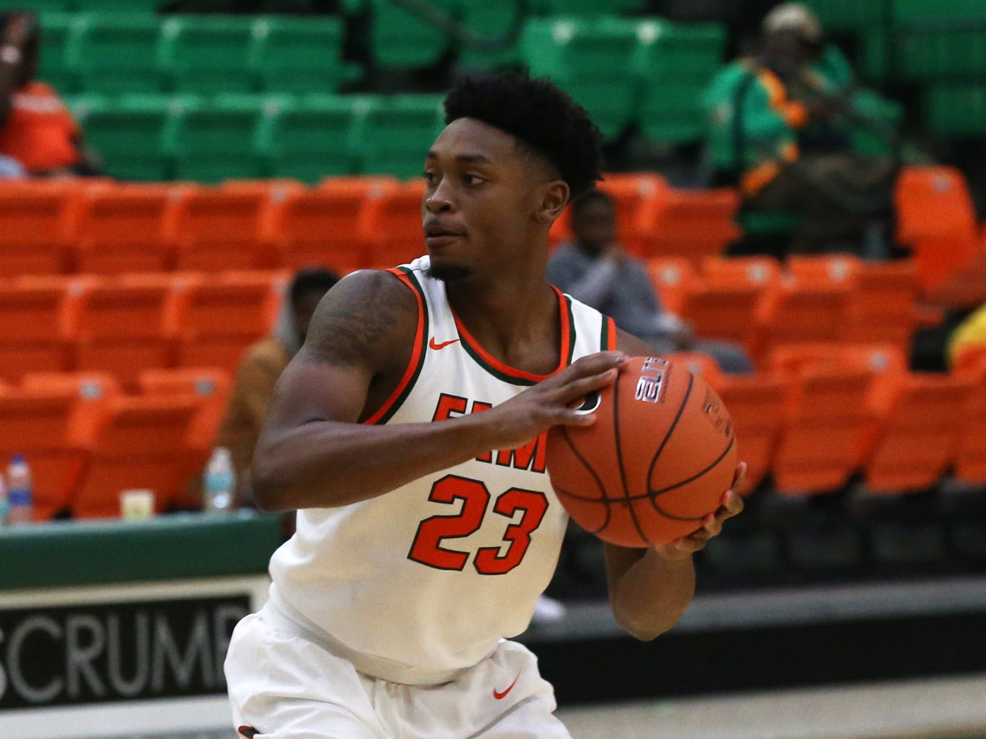 Florida A&M Rattlers forward Bryce Moragne (23) looks for an open player to pass to as the FAMU Rattlers take on the Tuskegee Golden Tigers in their first home game of the season in the Lawson Center, Saturday, Nov. 10, 2018.