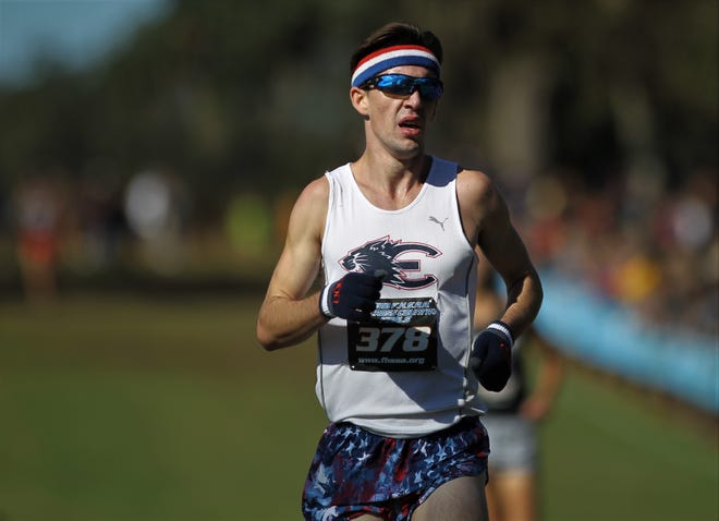 Estero senior Hugh Brittenham races to the finish in fifth place during his Class 3A race of the FHSAA Cross Country State Championships at Apalachee Regional Park in Tallahassee, Saturday, Nov. 11, 2018.