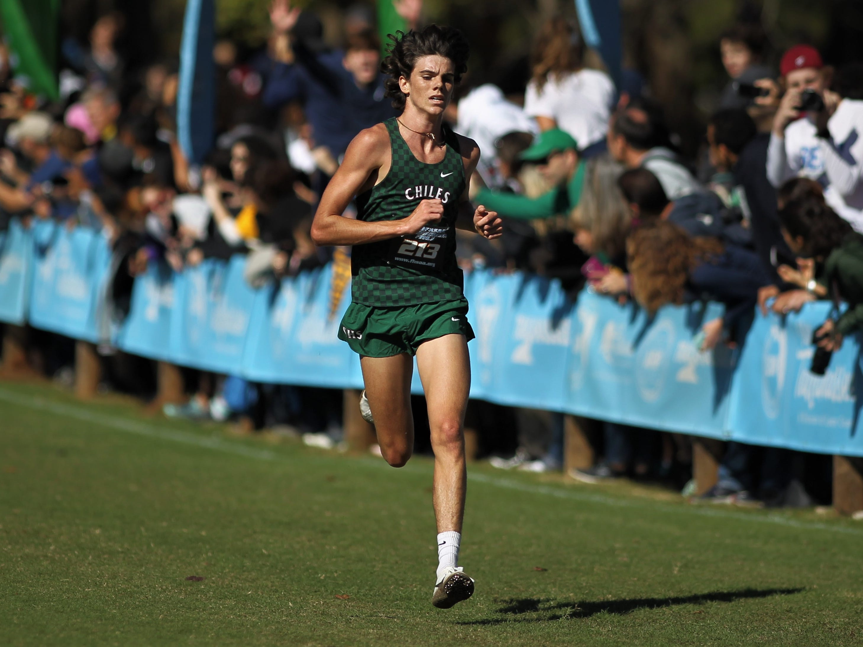 Chiles senior Connor Phillips runs to the finish of the Class 3A boys race in the FHSAA Cross Country State Championships at Apalachee Regional Park on Saturday, Nov. 10, 2018.