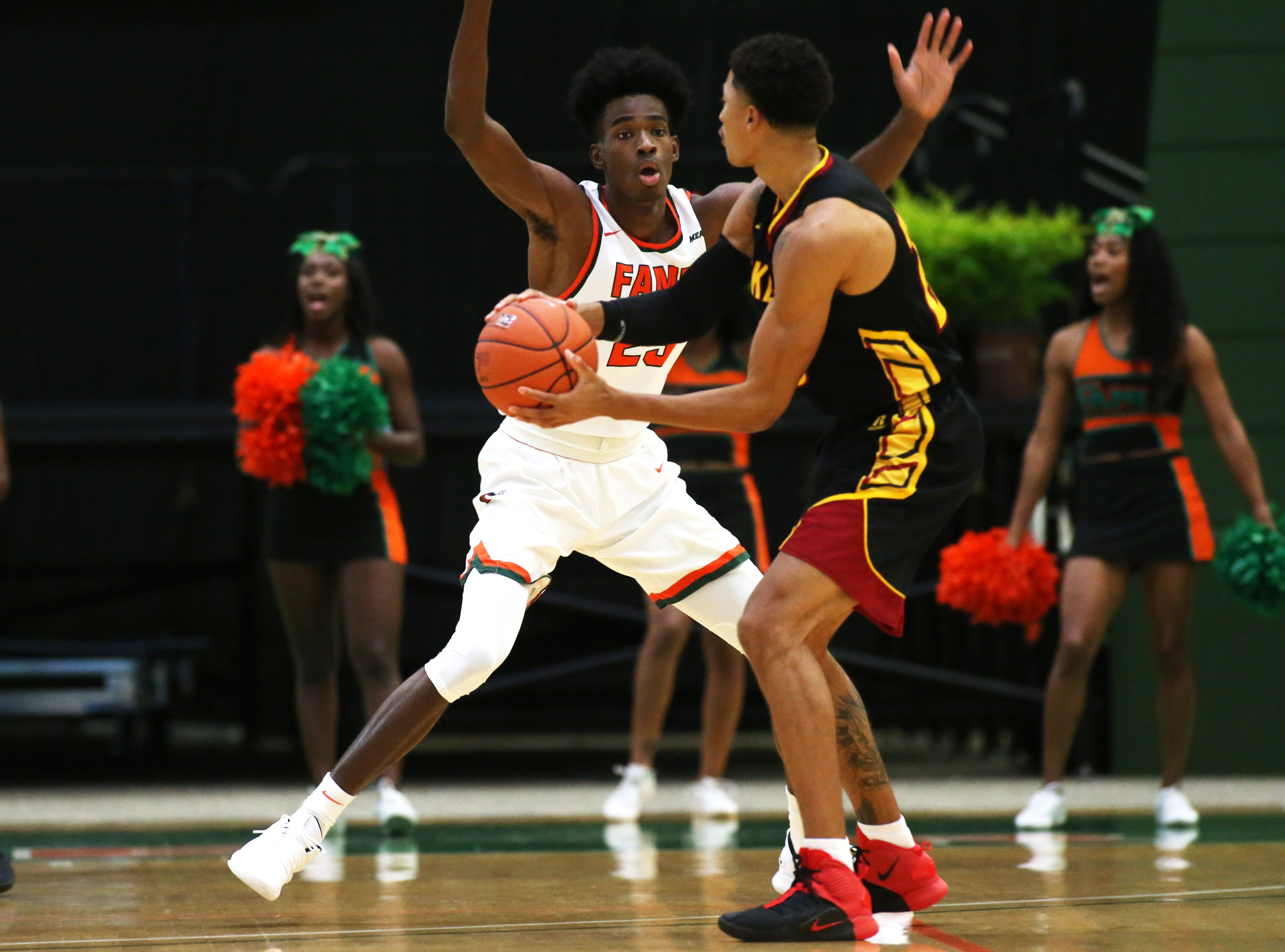Florida A&M Rattlers forward Bryce Moragne (23) guards a Tuskegee player as the FAMU Rattlers take on the Tuskegee Golden Tigers in their first home game of the season in the Lawson Center, Saturday, Nov. 10, 2018.
