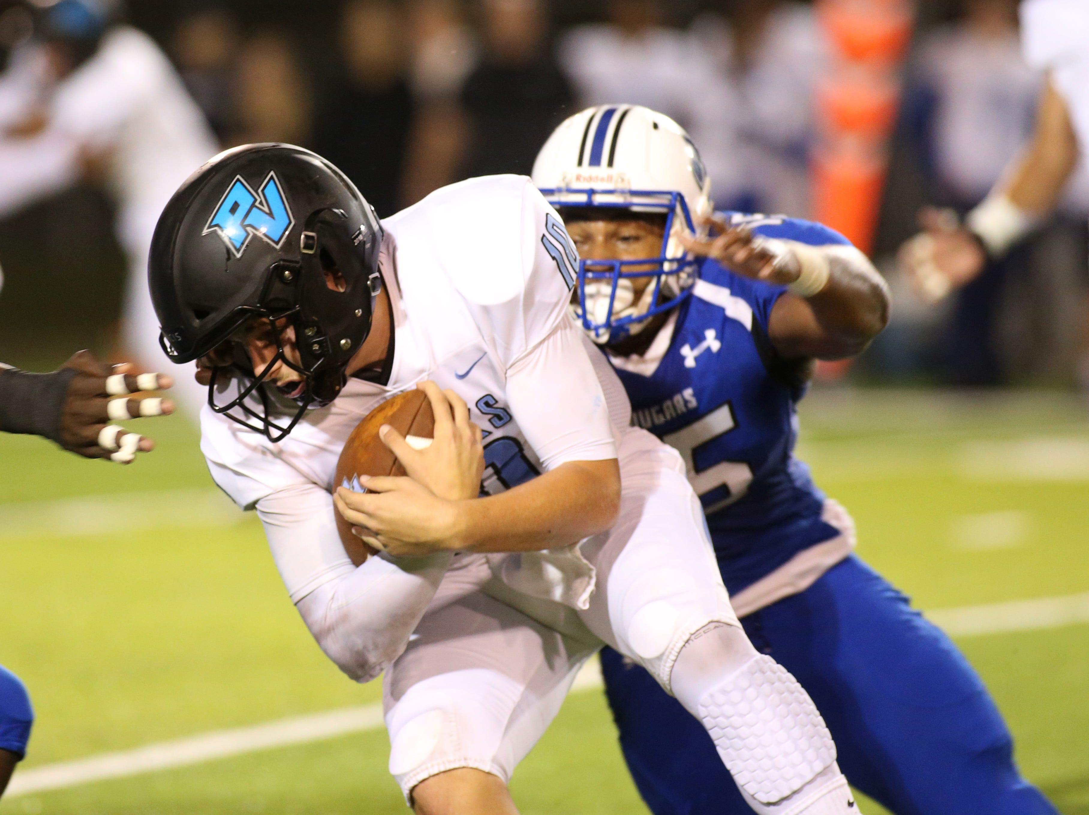 The Ponte Vedra Sharks face off against the Godby Cougars, in the Region 1-5A quarterfinal high school football playoff game at Gene Cox Stadium, Friday, Nov. 9, 2018.