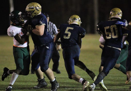 Warriors senior running back Blake Wirick finds running room, but FAMU DRS defeated Aucilla Christian 28-7 in a Region 1-2A quarterfinal playoff game on Friday, Nov. 9, 2018.