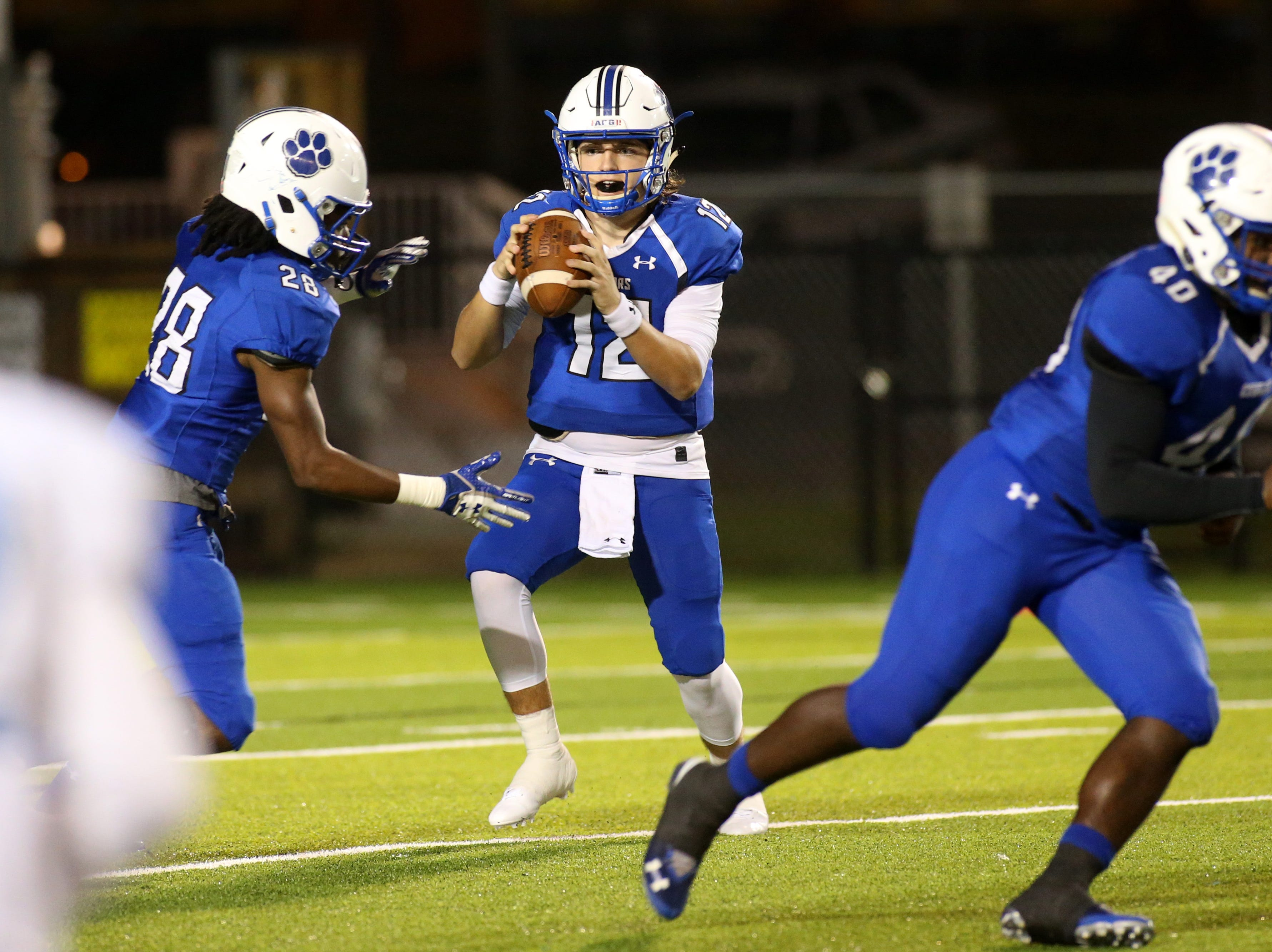 Godby quarterback, Tret Fisher looks to throw as the Ponte Vedra Sharks face off against the Godby Cougars, in the Region 1-5A quarterfinal high school football playoff game at Gene Cox Stadium, Friday, Nov. 9, 2018.