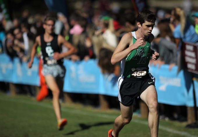Fort Myers' Joshua Robrahn races in the FHSAA Cross Country State Championships at Apalachee Regional Park in Tallahassee, Saturday, Nov. 11, 2018.