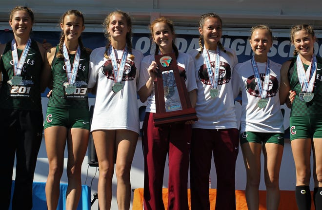 Chiles' girls cross country team celebrates a Class 3A state championship at the FHSAA Cross Country State Championships at Apalachee Regional Park on Saturday, Nov. 10, 2018. L-R: Megan Churchill, Lindsay James, Caitlin Wilkey, Emily Culley, Olivia Miller, Abby Schrobilgen, Alyson Churchill.
