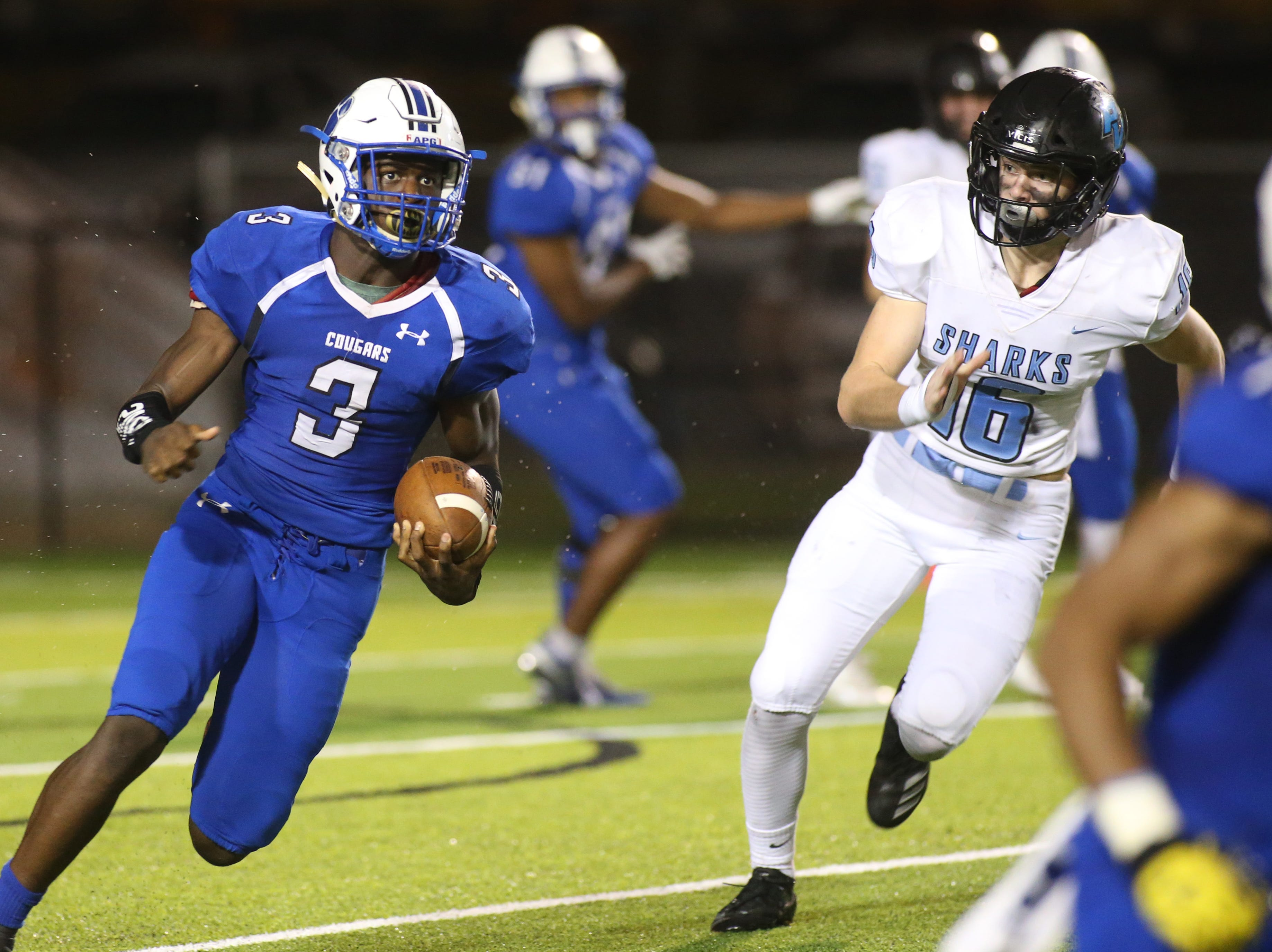 Godby running back Jaquez Yant (3) runs the ball to get a first down as the Ponte Vedra Sharks face off against the Godby Cougars, in the Region 1-5A quarterfinal high school football playoff game at Gene Cox Stadium, Friday, Nov. 9, 2018.