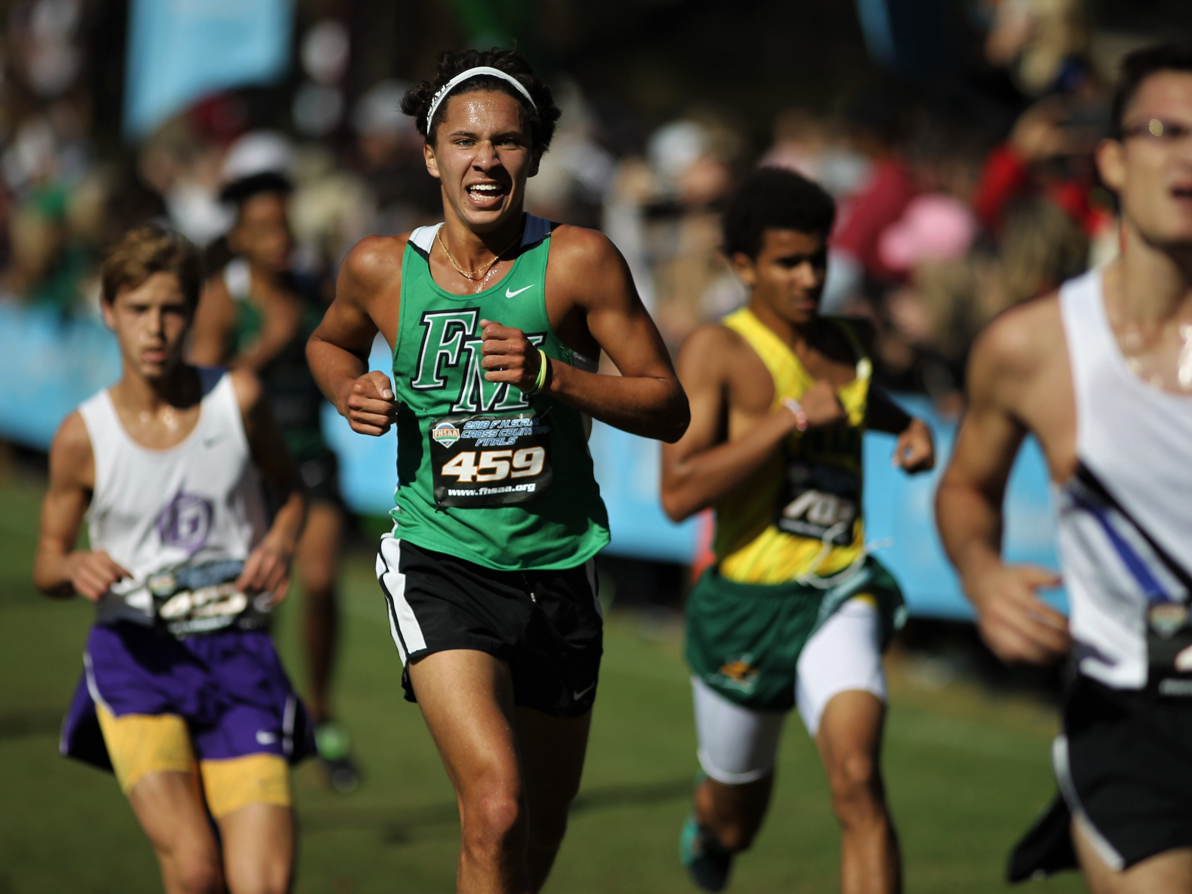 Fort Myers' Jonathan Edwards races in the FHSAA Cross Country State Championships at Apalachee Regional Park in Tallahassee, Saturday, Nov. 11, 2018.
