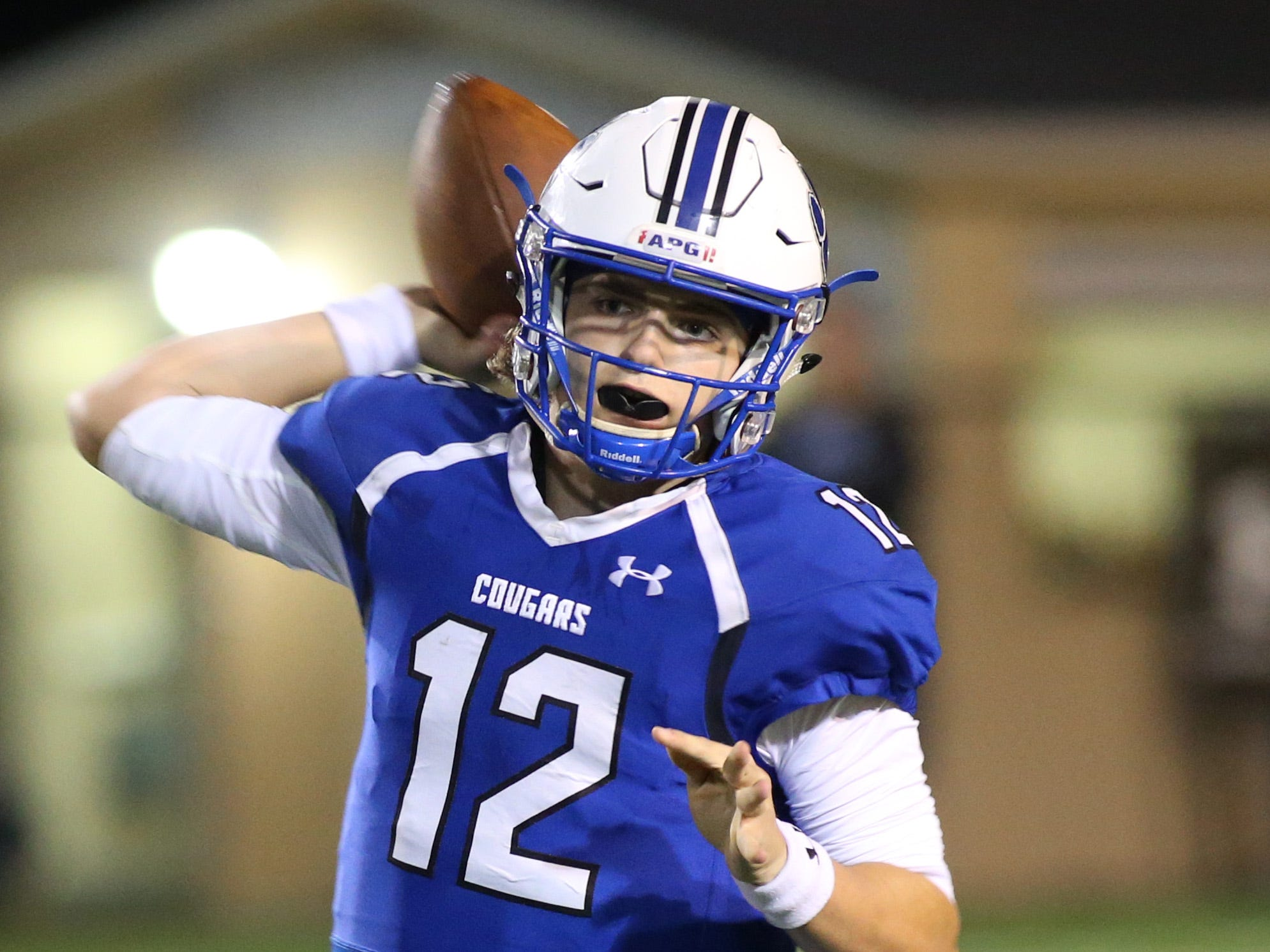 Godby quarterback, Trey Fisher (12) throws the ball to an open player as the Ponte Vedra Sharks face off against the Godby Cougars, in the Region 1-5A quarterfinal high school football playoff game at Gene Cox Stadium, Friday, Nov. 9, 2018.