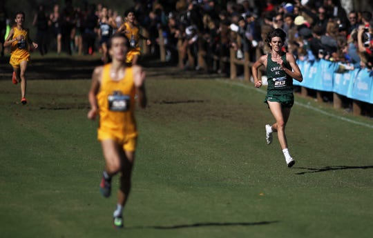 Surrounded by Belen Jesuit runners, Chiles senior Connor Phillips kicks to the finish of the Class 3A boys race in the FHSAA Cross Country State Championships at Apalachee Regional Park on Saturday, Nov. 10, 2018.