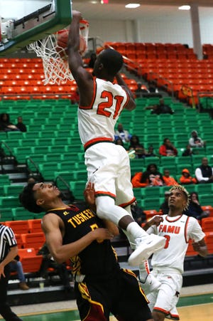FAMU guard Justin Ravenel (21) posterized Riley Hamilton with a vicious dunk. The Rattlers defeated Tuskegee 62-55 in their home opener on Saturday, Nov. 10.