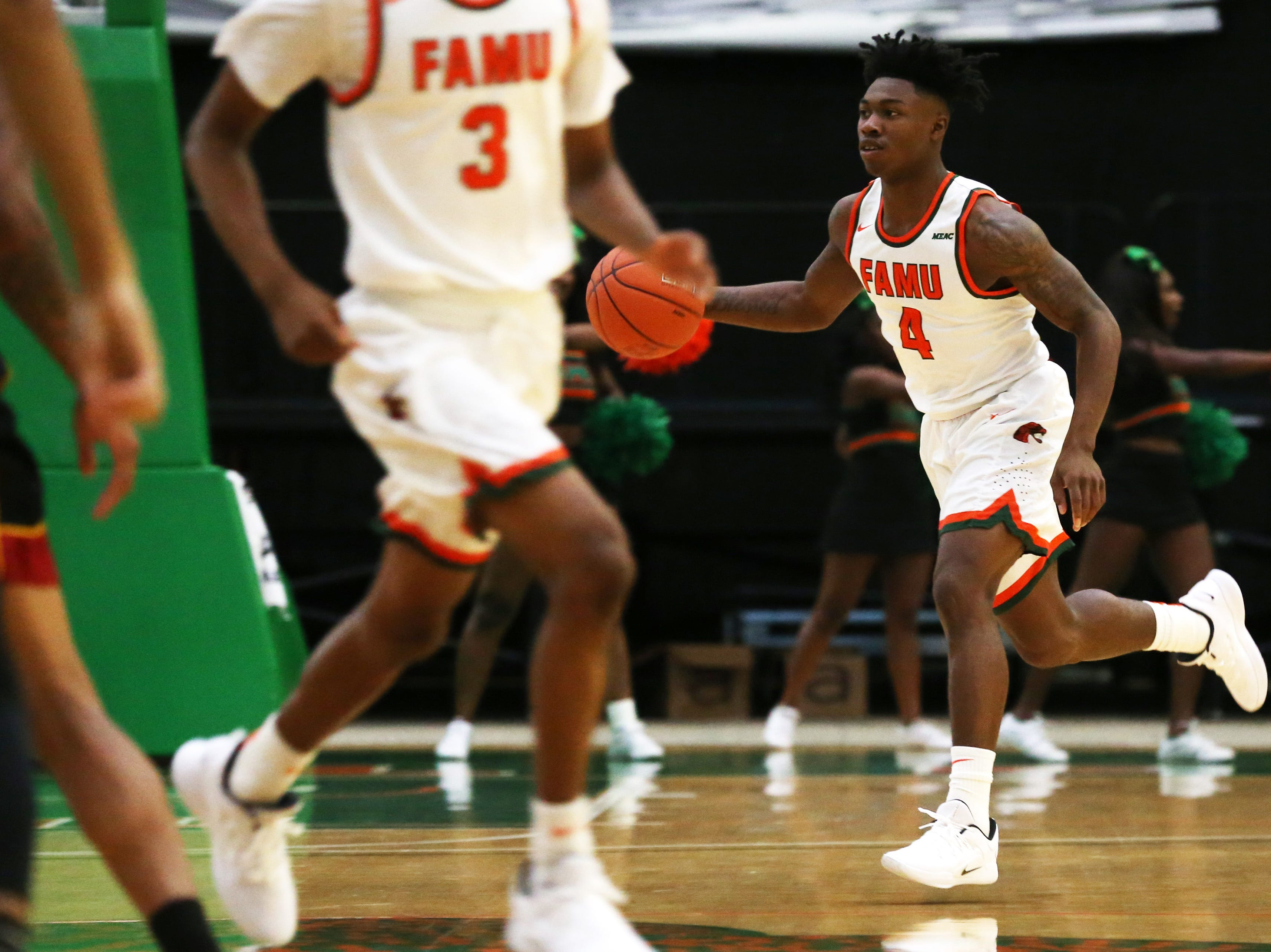 Florida A&M Rattlers guard Rod Melton Jr. (4) drives the ball down the court as the FAMU Rattlers take on the Tuskegee Golden Tigers in their first home game of the season in the Lawson Center, Saturday, Nov. 10, 2018.