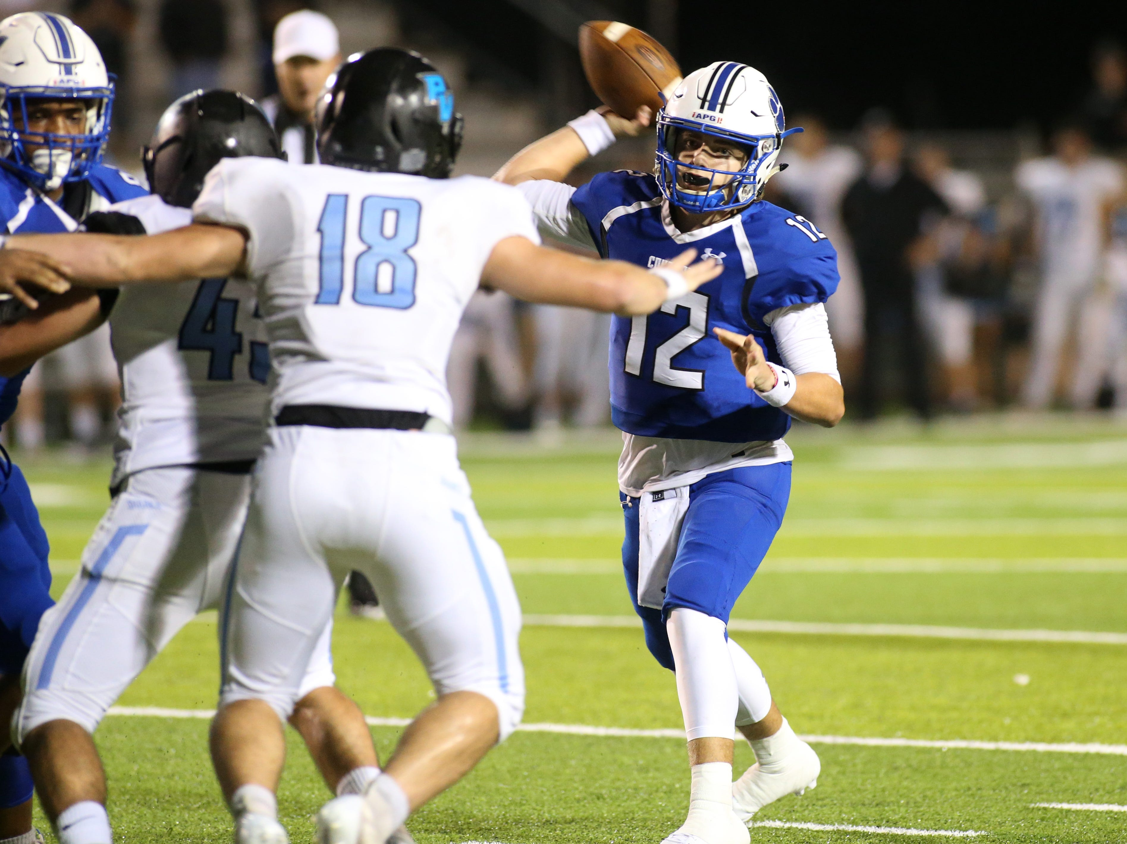 Godby quarterback, Trey Fisher (12) goes to throw the ball as the  Ponte Vedra Sharks face off against the Godby Cougars, in the Region 1-5A quarterfinal high school football playoff game at Gene Cox Stadium, Friday, Nov. 9, 2018.