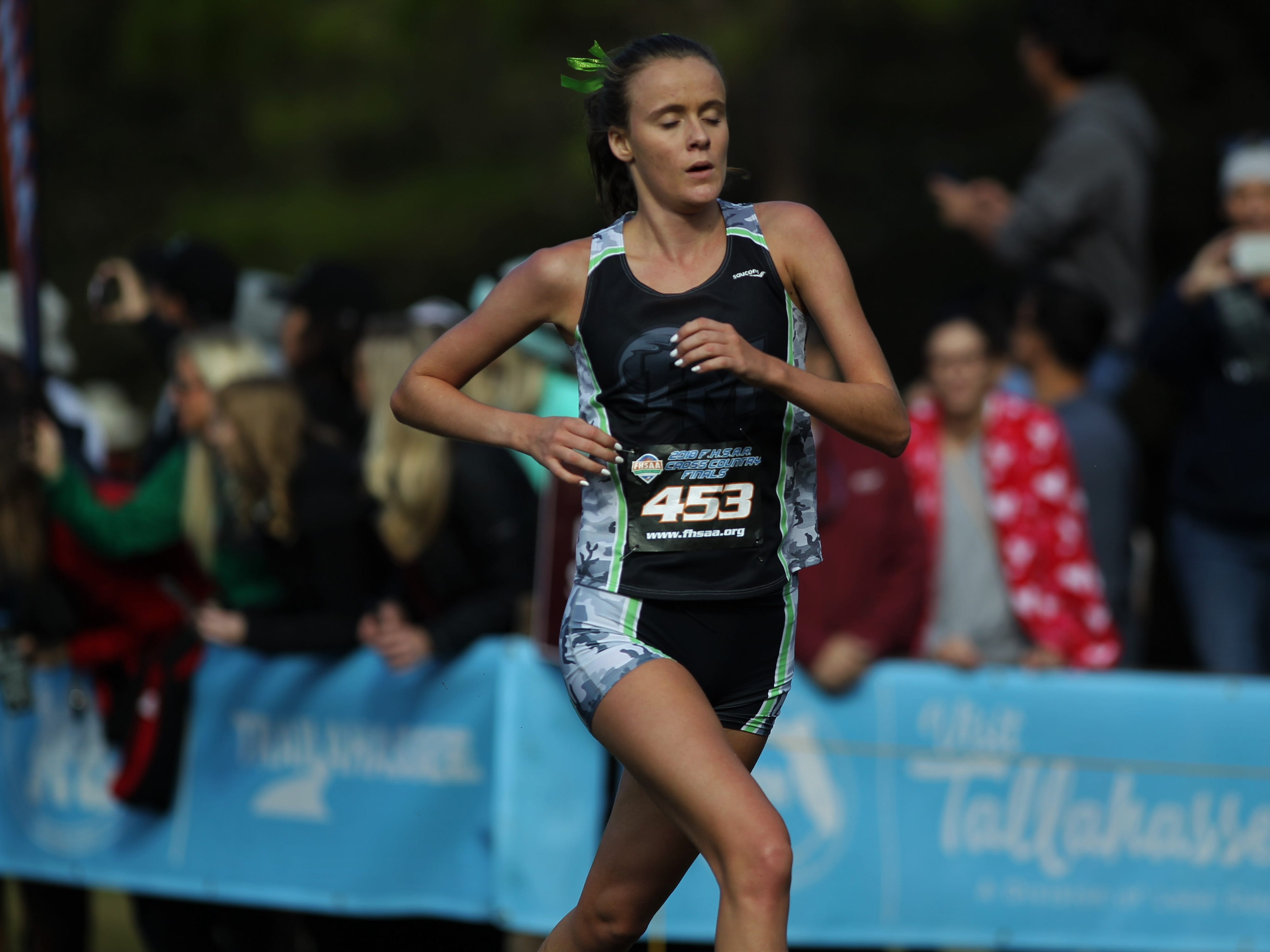 Fort Myers' Caroline Mackenzie races at the FHSAA Cross Country State Championships at Apalachee Regional Park in Tallahassee, Saturday, Nov. 11, 2018.