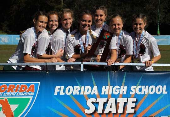 Chiles' girls cross country team celebrates a Class 3A state championship at the FHSAA Cross Country State Championships at Apalachee Regional Park on Saturday, Nov. 10, 2018. L-R: Lindsay James, Emily Culley, Caitlin Wilkey, Olivia Miller, Megan Churchill, Abby Schrobilgen, Alyson Churchill.