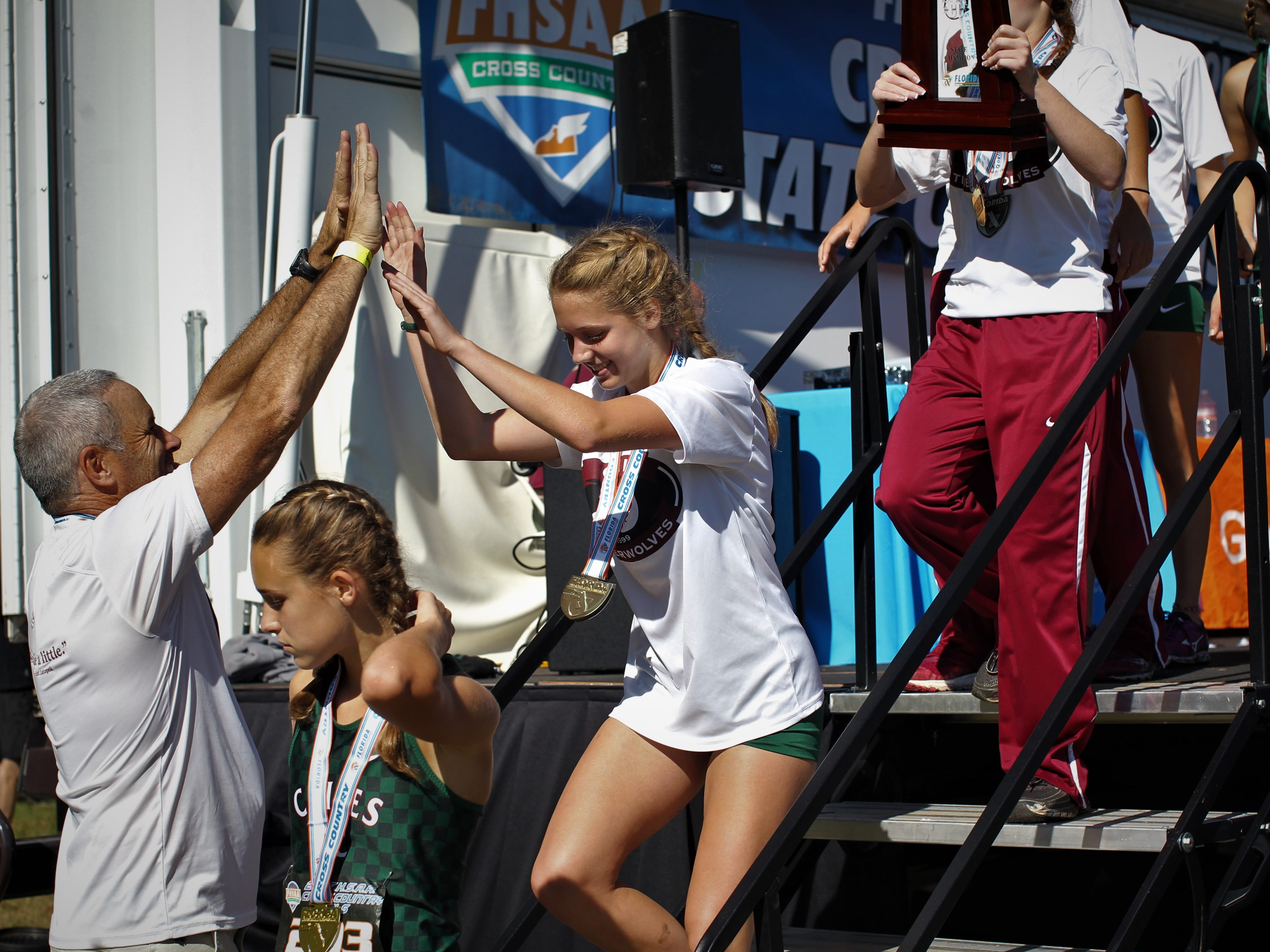 Chiles' girls cross country team celebrates a Class 3A state championship at the FHSAA Cross Country State Championships at Apalachee Regional Park on Saturday, Nov. 10, 2018.