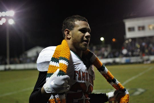 Rattlers linebacker Jalen Randolph celebrates with his team's turnover scarf following an interception, and FAMU DRS defeated Aucilla Christian 28-7 in a Region 1-2A quarterfinal playoff game on Friday, Nov. 9, 2018.