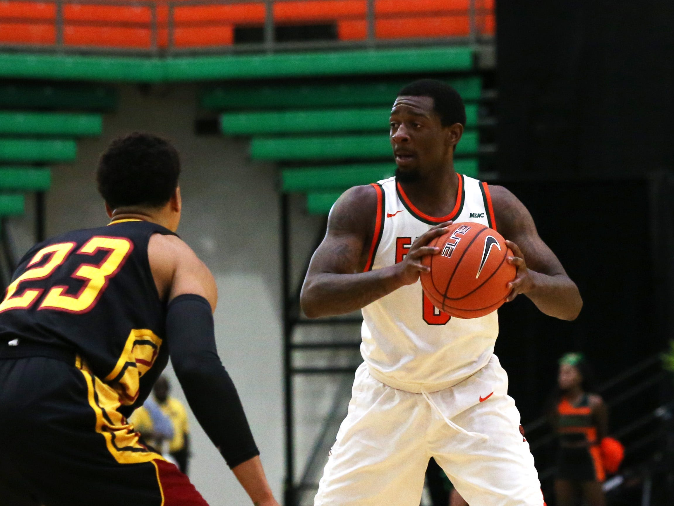 Florida A&M Rattlers forward Tracy Hector Jr. (0) looks to pass as the FAMU Rattlers take on the Tuskegee Golden Tigers in their first home game of the season in the Lawson Center, Saturday, Nov. 10, 2018.