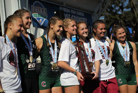 Chiles' girls cross country team celebrates a Class 3A state championship at the FHSAA Cross Country State Championships at Apalachee Regional Park on Saturday, Nov. 10, 2018. L-R: Abby Schrobilgen, Megan Churchill, Lindsay James, Caitlin Wilkey, Emily Culley, Olivia Miller, Alyson Churchill.
