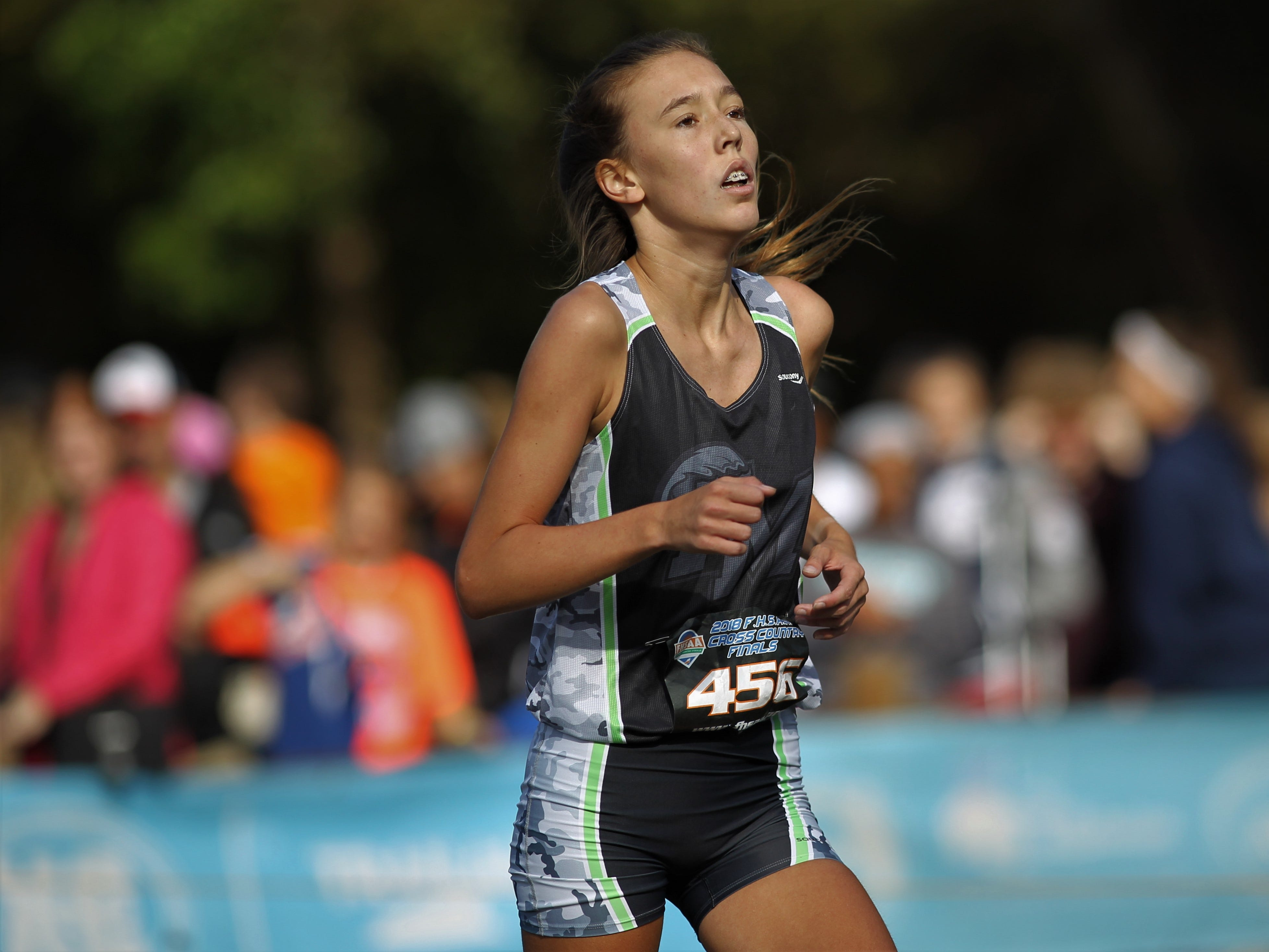 Fort Myers' Sarah Schultz races at the FHSAA Cross Country State Championships at Apalachee Regional Park in Tallahassee, Saturday, Nov. 11, 2018.