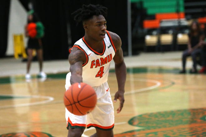 Florida A&M guard Rod Melton Jr. (4) passes to a teammate versus Tuskegee. FAMU faces Savannah State in its MEAC home opener on Jan. 12.