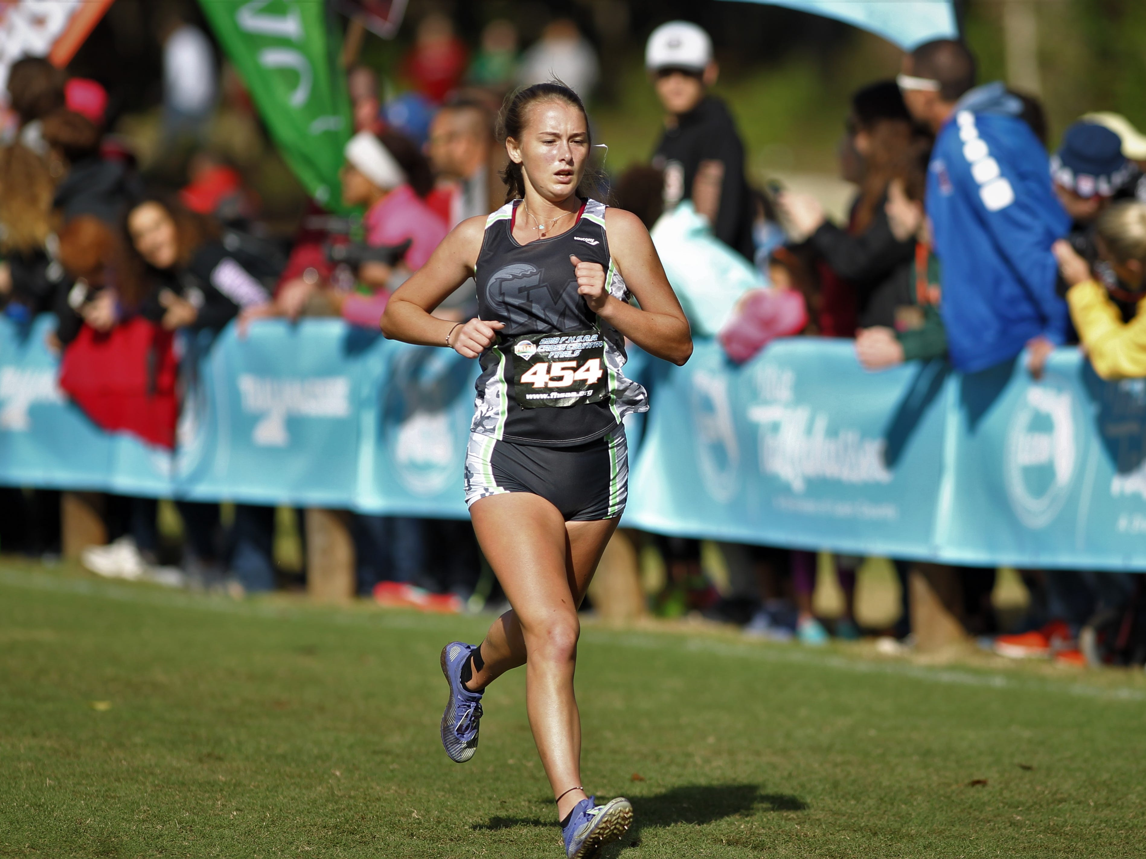 Fort Myers' Mallory Marker races at the FHSAA Cross Country State Championships at Apalachee Regional Park in Tallahassee, Saturday, Nov. 11, 2018.