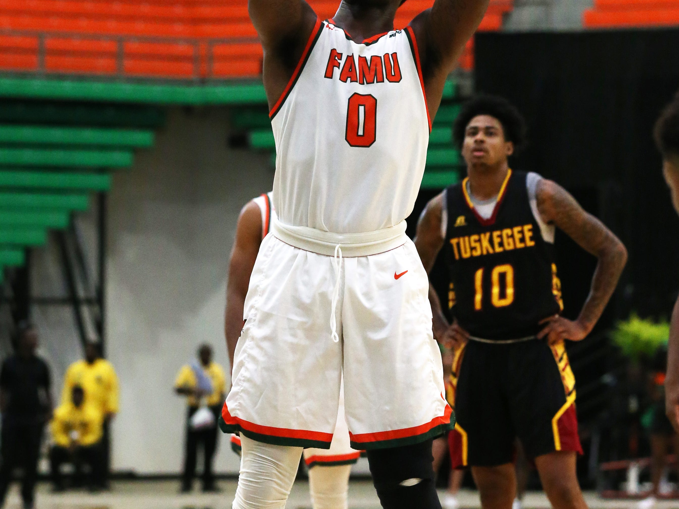 Florida A&M Rattlers forward Tracy Hector Jr. (0) shoots a free throw as the FAMU Rattlers take on the Tuskegee Golden Tigers in their first home game of the season in the Lawson Center, Saturday, Nov. 10, 2018.