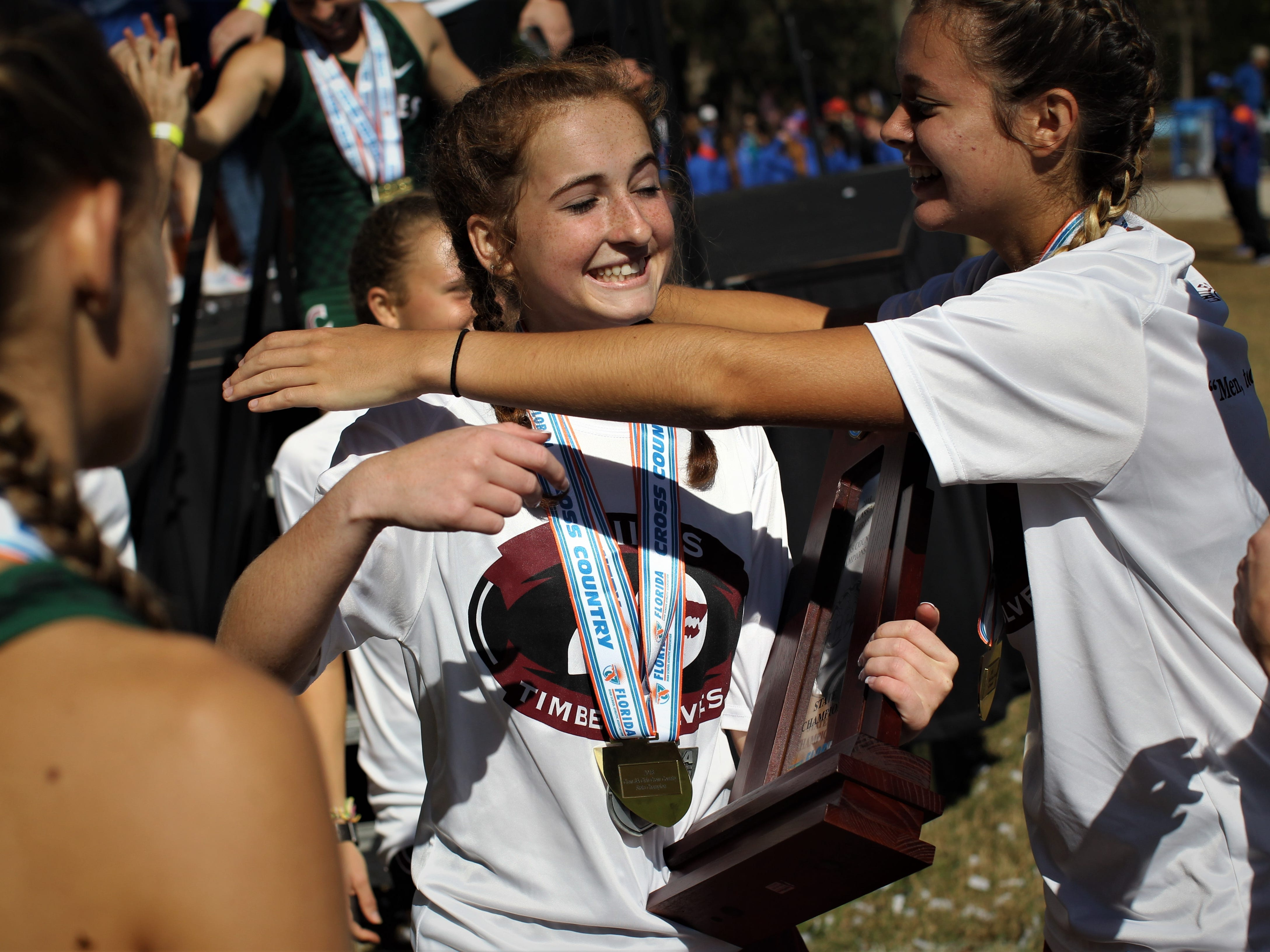 Olivia Miller hugs Emily Culley as Chiles' girls cross country team celebrates a Class 3A state championship at the FHSAA Cross Country State Championships at Apalachee Regional Park on Saturday, Nov. 10, 2018.