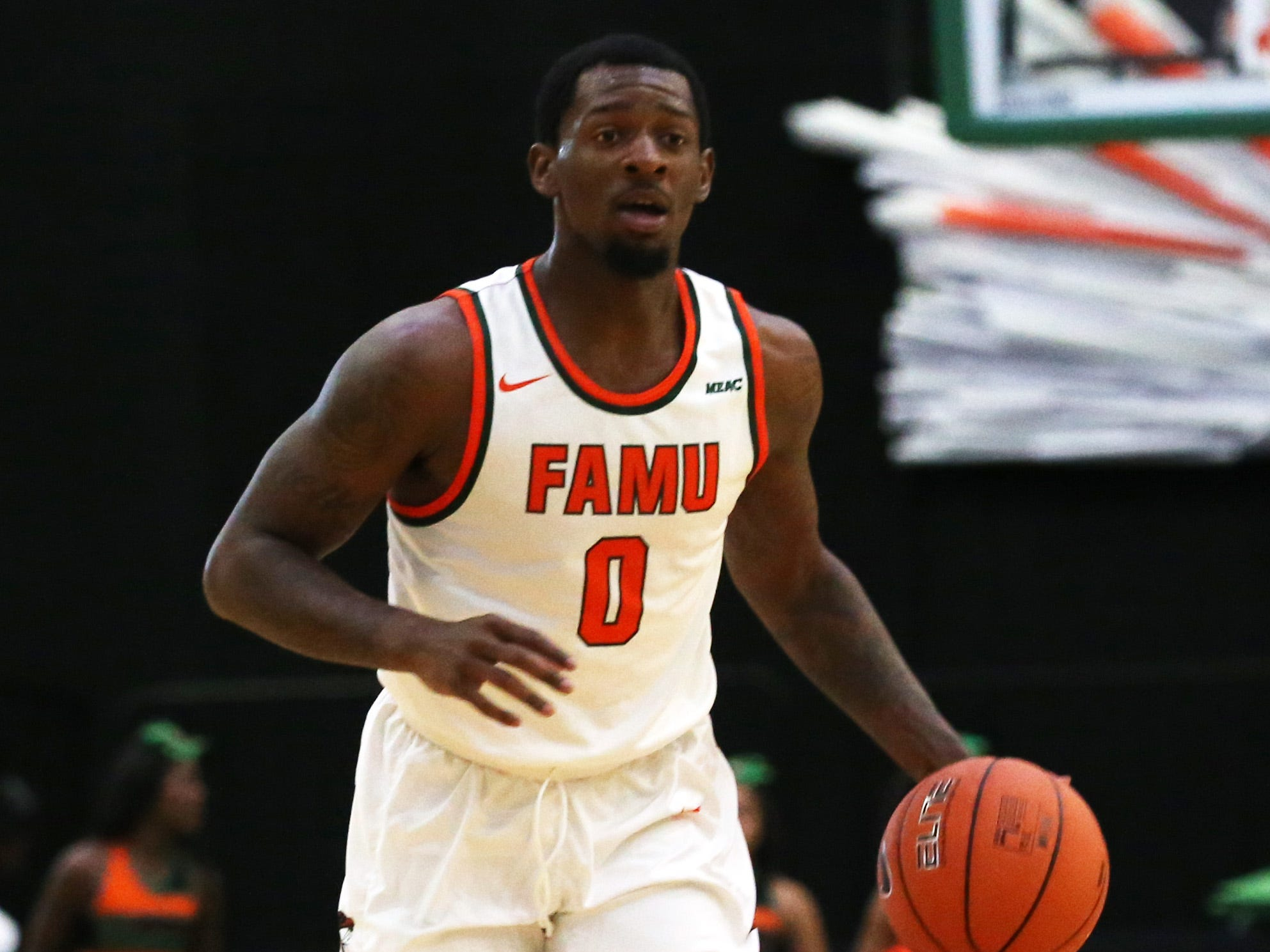Florida A&M Rattlers forward Tracy Hector Jr. (0) drives the ball down the court as the FAMU Rattlers take on the Tuskegee Golden Tigers in their first home game of the season in the Lawson Center, Saturday, Nov. 10, 2018.