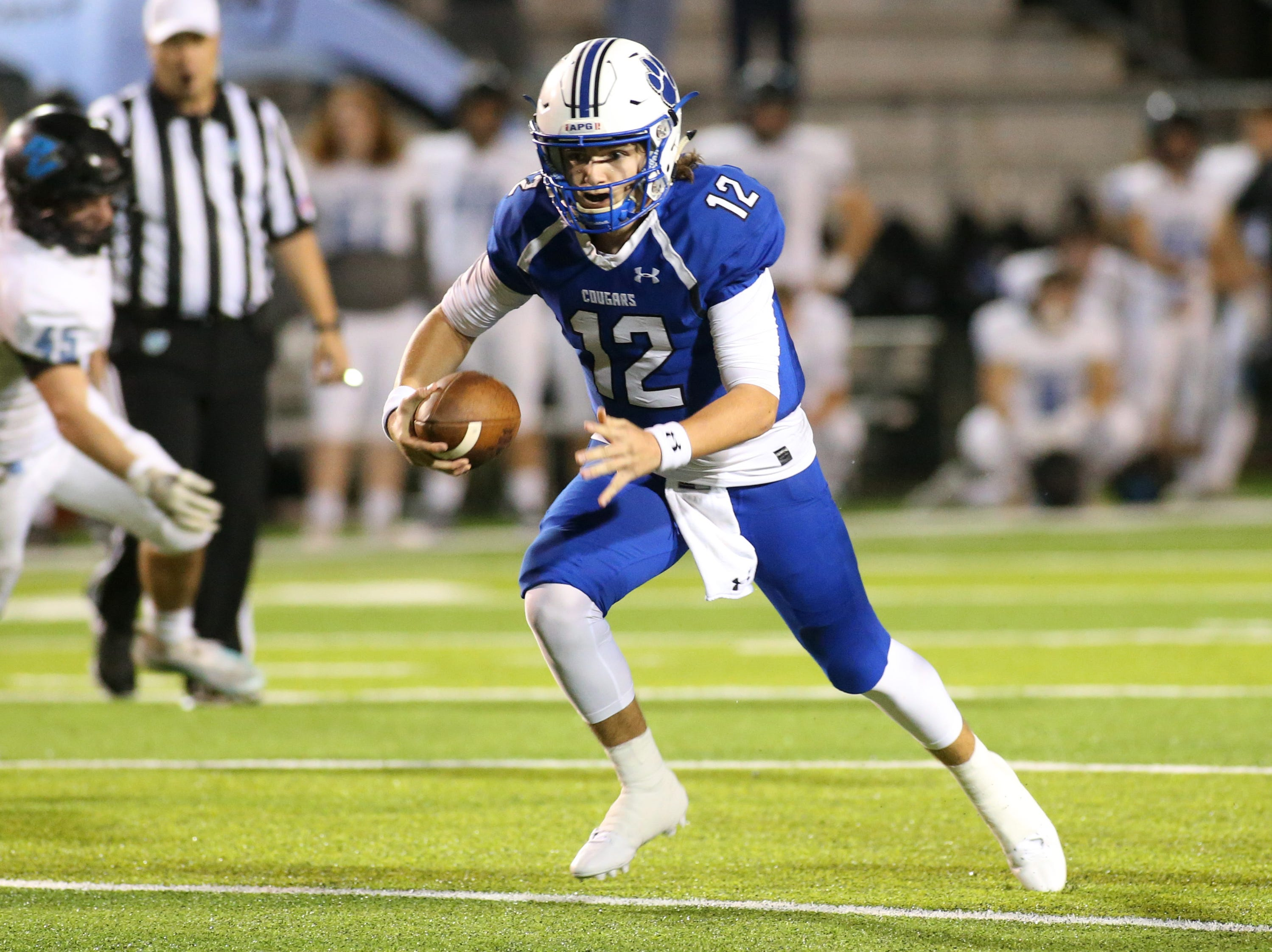 Godby quarterback, Trey Fisher (12) runs the ball as the Ponte Vedra Sharks face off against the Godby Cougars, in the Region 1-5A quarterfinal high school football playoff game at Gene Cox Stadium, Friday, Nov. 9, 2018.