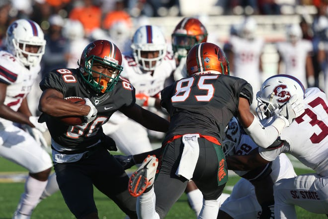 FAMU wide receiver Marcus Williams fights for yardage after during a home game versus South Carolina State on Nov. 10, 2018 at Bragg Memorial Stadium.