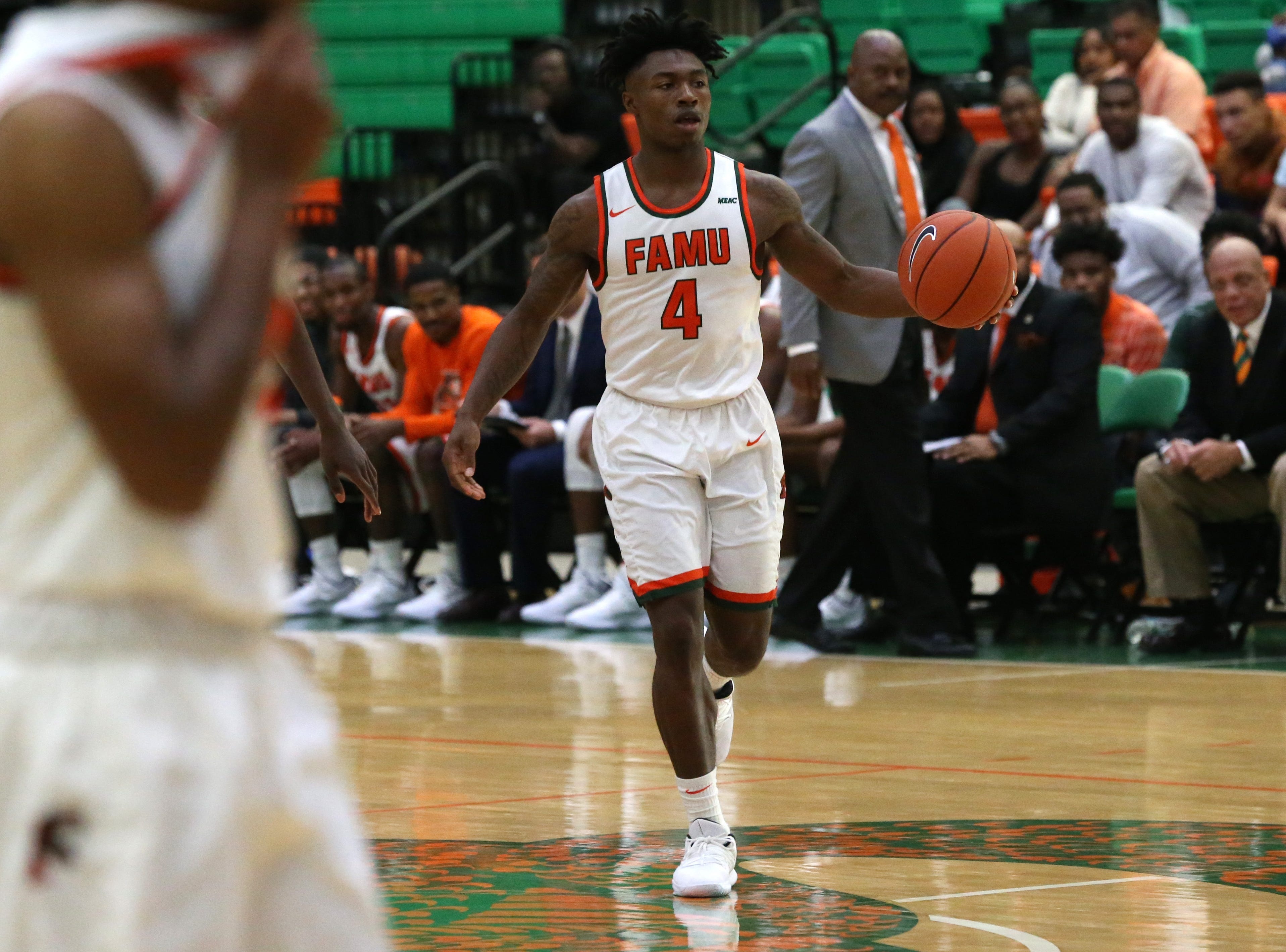 Florida A&M Rattlers guard Rod Melton Jr. (4) contemplates on passing or shooting as the FAMU Rattlers take on the Tuskegee Golden Tigers in their first home game of the season in the Lawson Center, Saturday, Nov. 10, 2018.