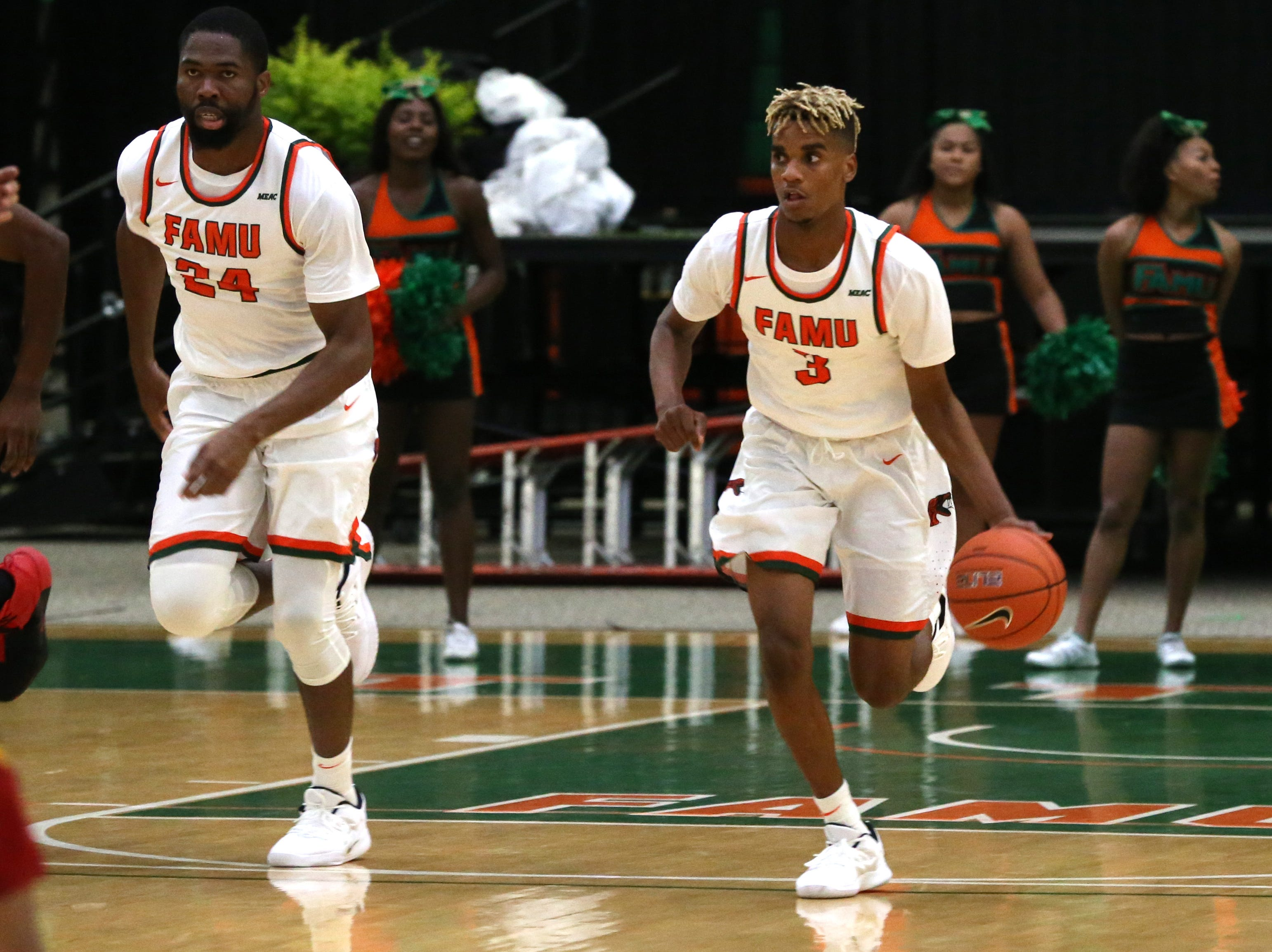 Florida A&M Rattlers guard MJ Randolph (3) drives down the court as the FAMU Rattlers take on the Tuskegee Golden Tigers in their first home game of the season in the Lawson Center, Saturday, Nov. 10, 2018.