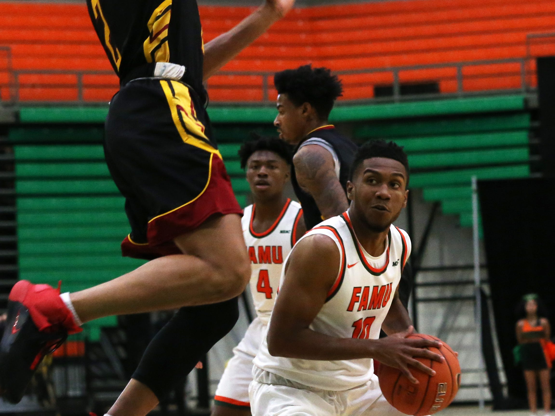 Florida A&M Rattlers guard Richard Anderson (10) tries to shoot the ball as the FAMU Rattlers take on the Tuskegee Golden Tigers in their first home game of the season in the Lawson Center, Saturday, Nov. 10, 2018.