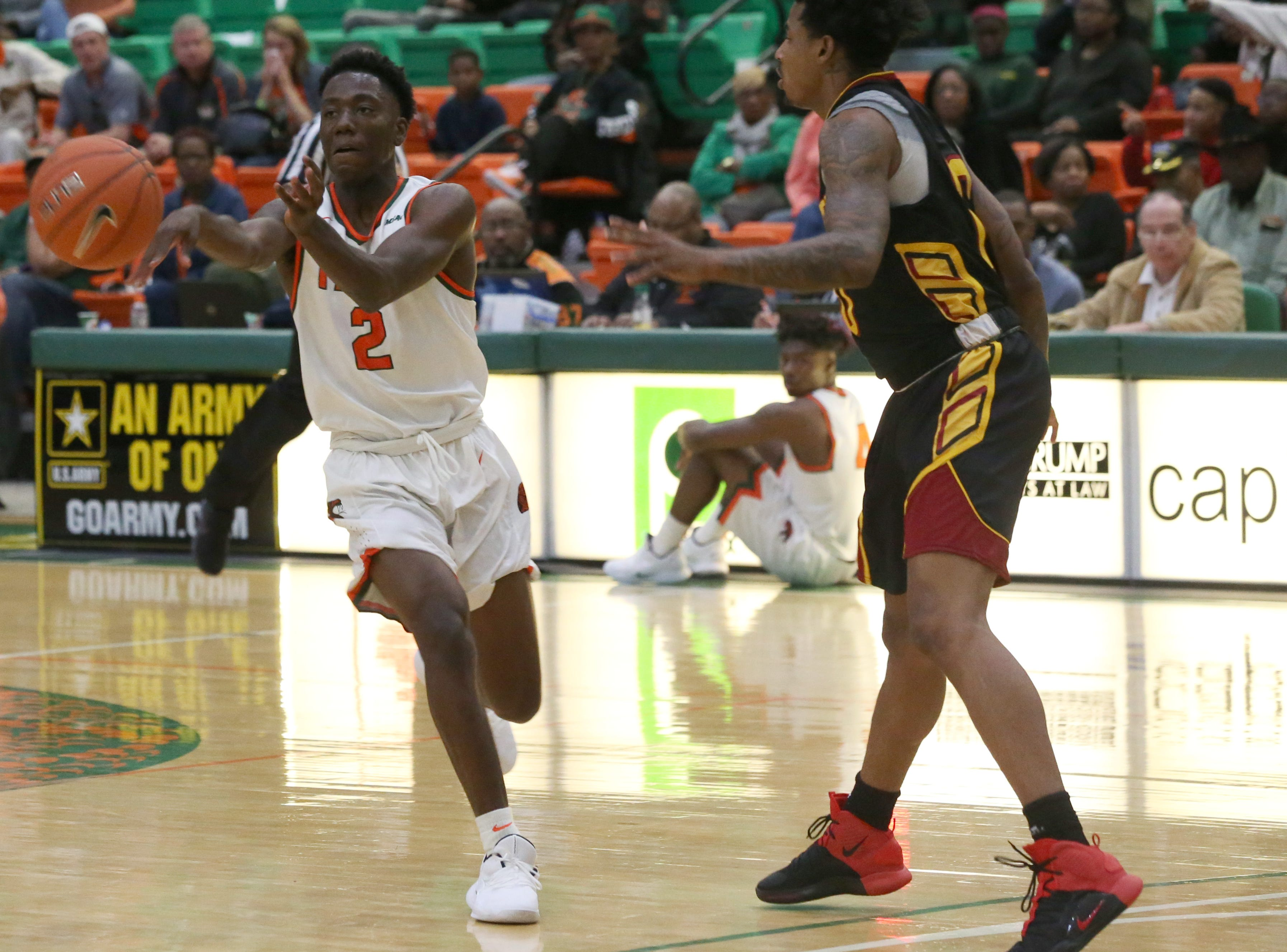 Florida A&M Rattlers guard Kamron Reaves (2) passes to a teammate as the FAMU Rattlers take on the Tuskegee Golden Tigers in their first home game of the season in the Lawson Center, Saturday, Nov. 10, 2018.