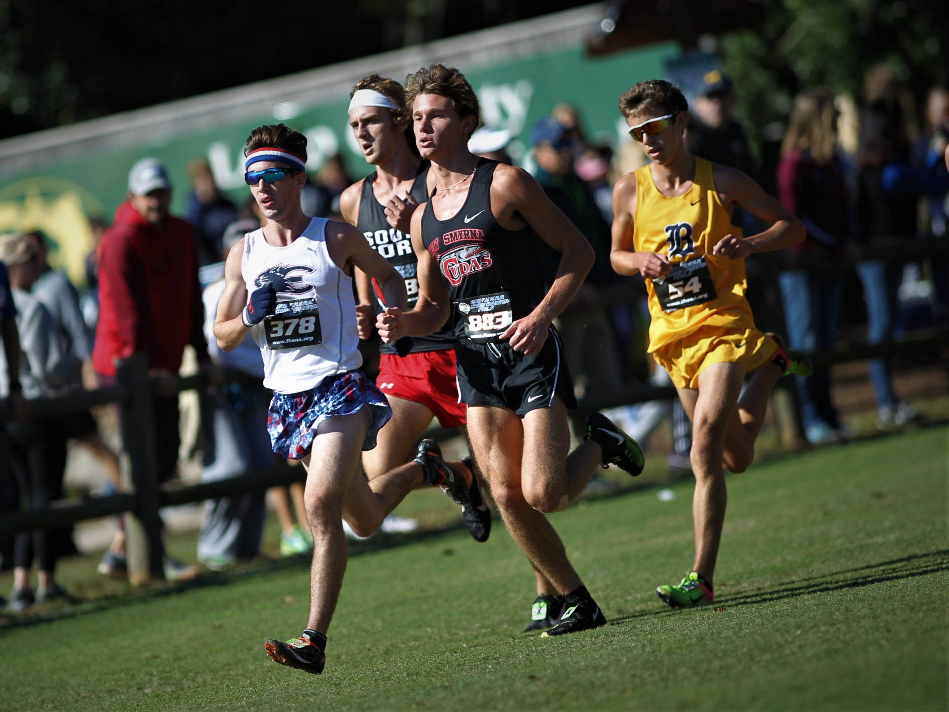 Estero senior Hugh Brittenham leads during his Class 3A state race in the FHSAA Cross Country State Championships at Apalachee Regional Park in Tallahassee, Saturday, Nov. 11, 2018.