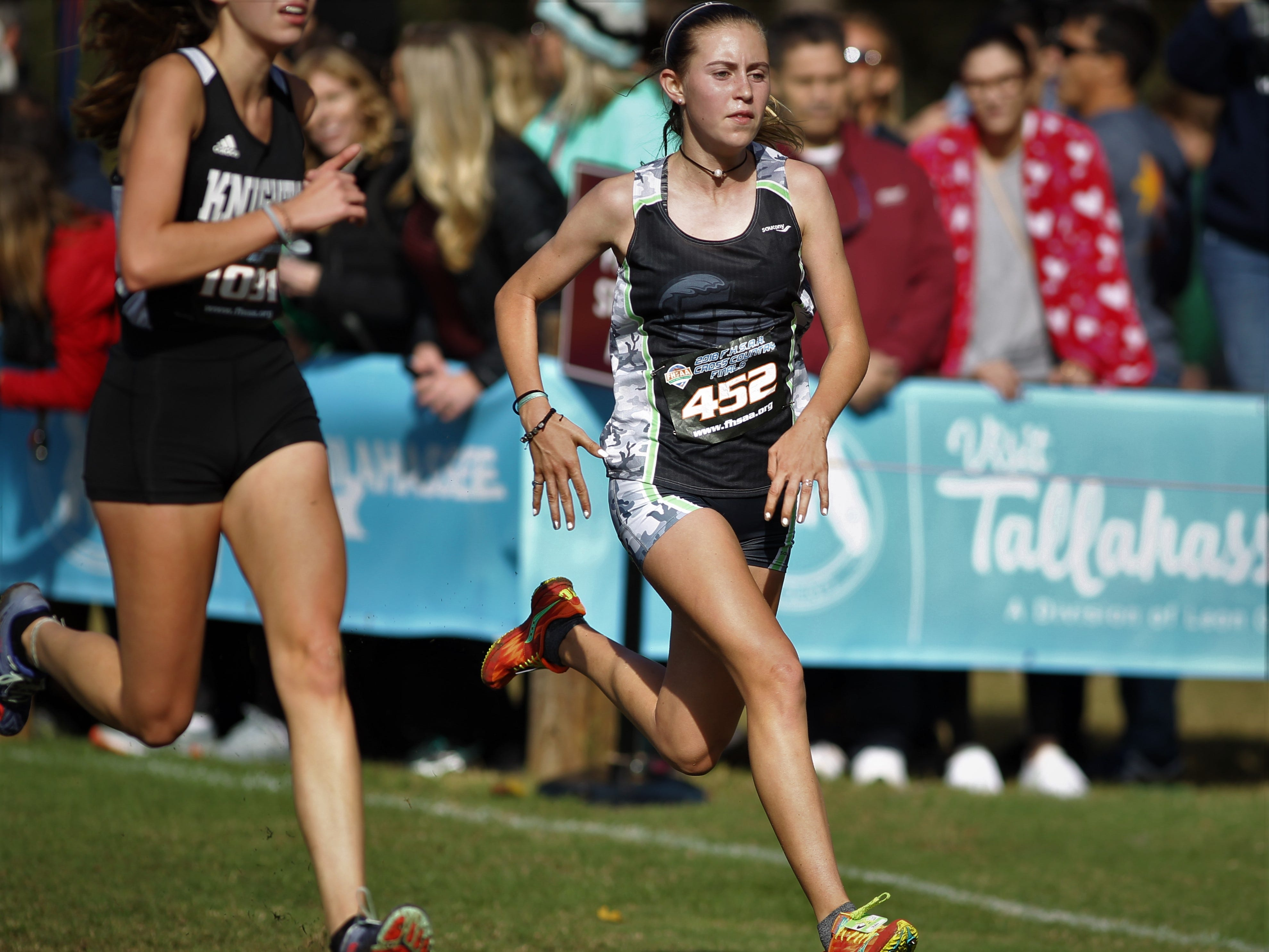 Fort Myers freshman Ava Lees races at the FHSAA Cross Country State Championships at Apalachee Regional Park in Tallahassee, Saturday, Nov. 11, 2018.
