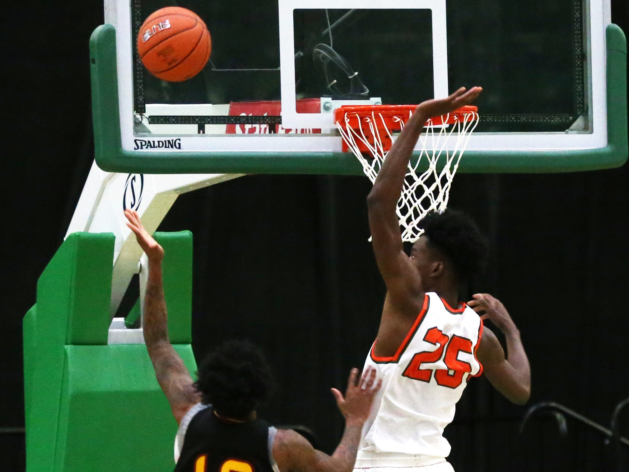 Florida A&M Rattlers center DJ Jones (25) blocks a Tuskegee player as the FAMU Rattlers take on the Tuskegee Golden Tigers in their first home game of the season in the Lawson Center, Saturday, Nov. 10, 2018.