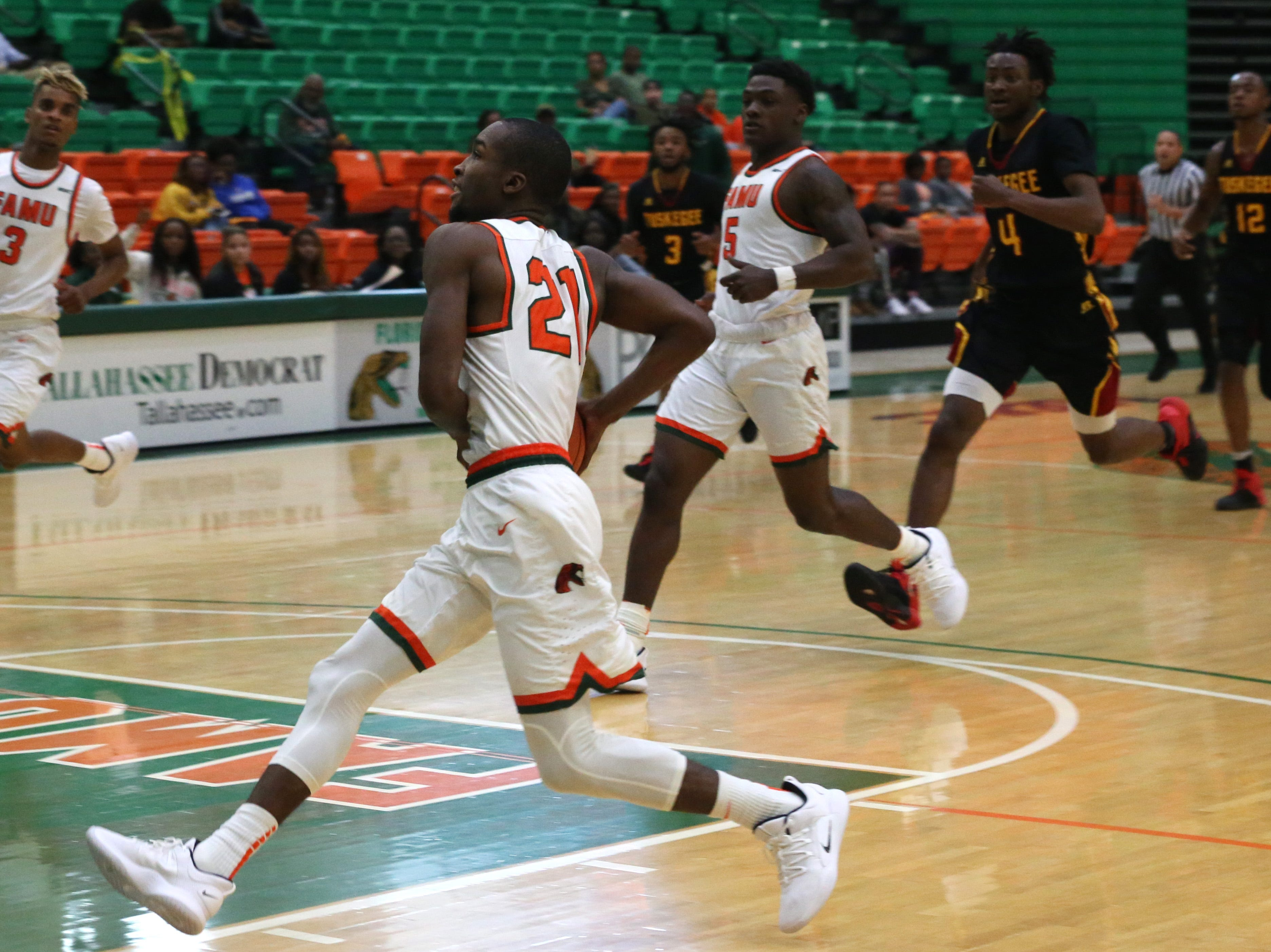 Florida A&M Rattlers guard Justin Ravenel (21) goes to dunk as the FAMU Rattlers take on the Tuskegee Golden Tigers in their first home game of the season in the Lawson Center, Saturday, Nov. 10, 2018.