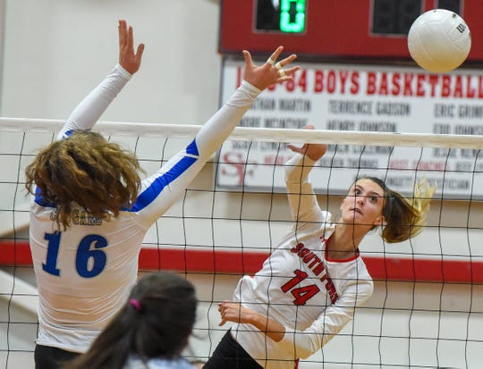 South Fork's Angela Grieve (14) gets a kill Saturday, Nov. 10, 2018, during her team's high school state semi-final volleyball match against Barron Collier (Naples) at South Fork High School in Tropical Farms. South Fork defeated Barron Collier (Naples) 3-2.